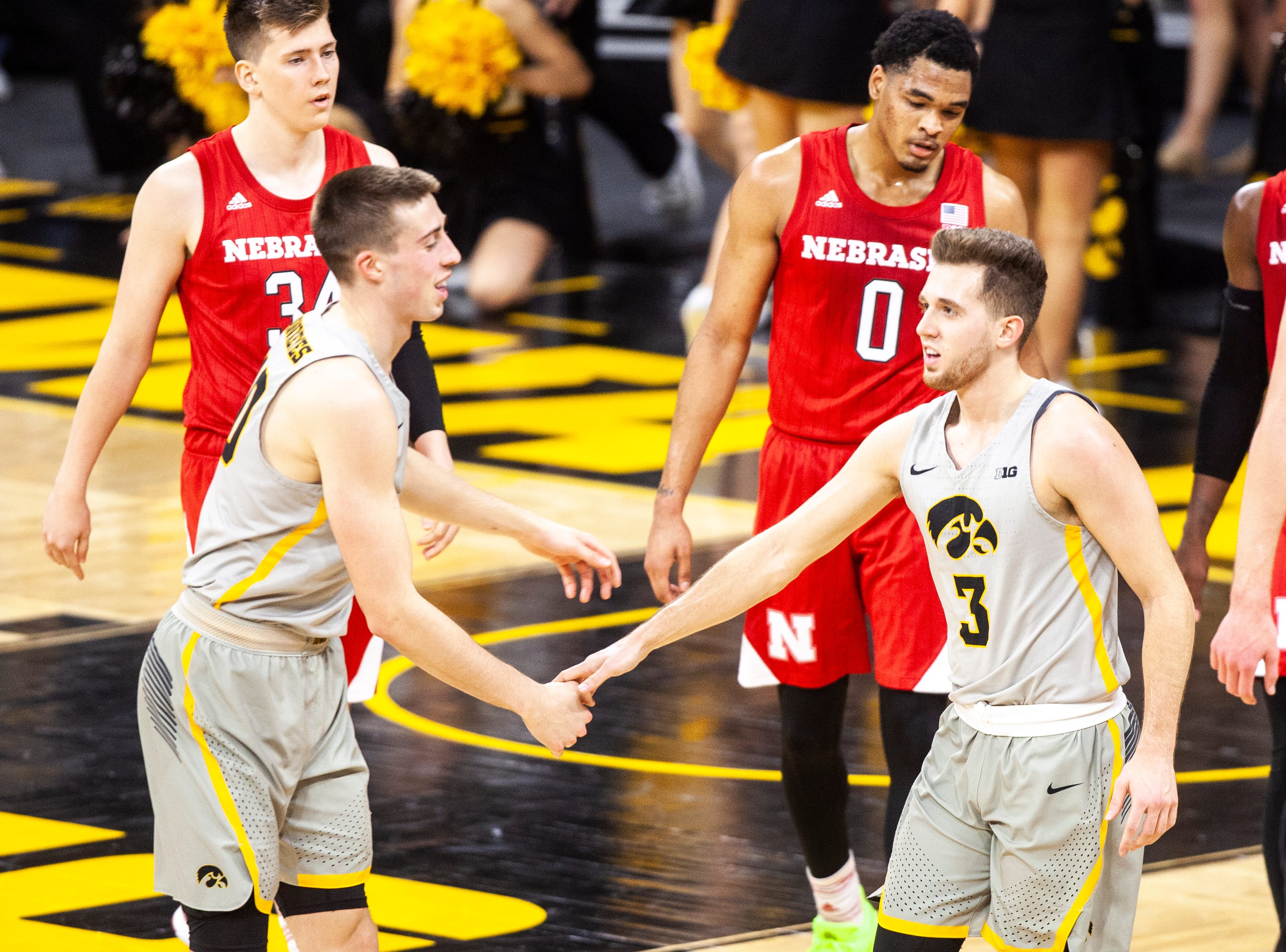 Iowa guard Jordan Bohannon (3) gets a high-five from Iowa guard Joe Wieskamp (10) after making a 3-point basket at the end of the first half during a NCAA Big Ten Conference men's basketball game on Sunday, Jan. 6, 2019, at the Carver-Hawkeye Arena in Iowa City, Iowa.