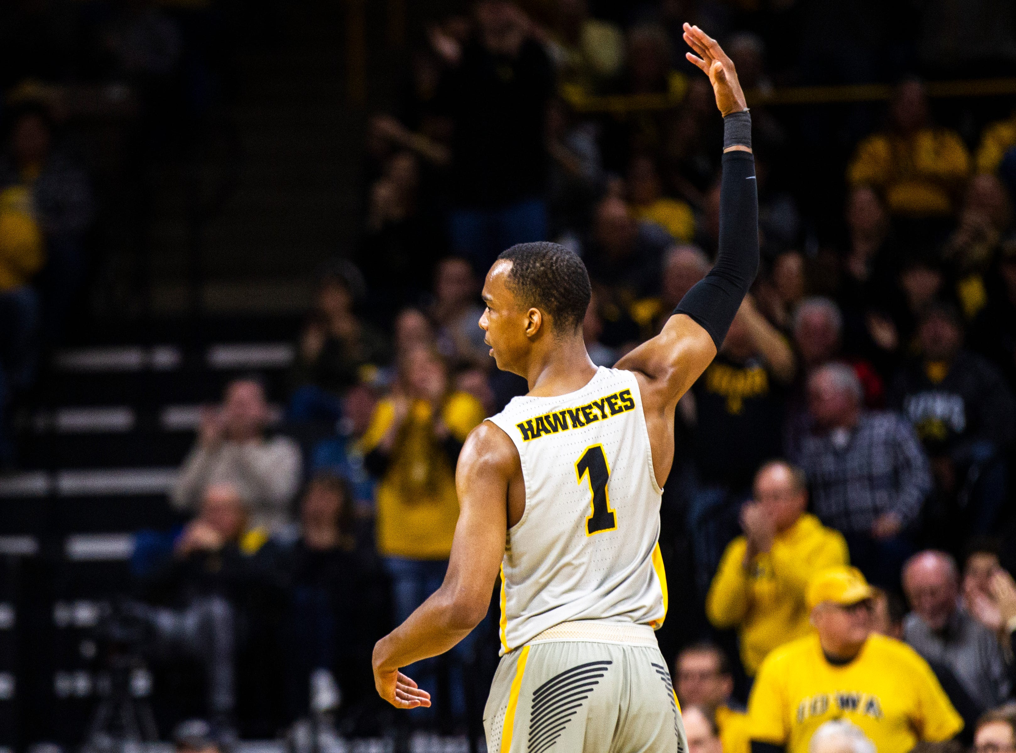 Iowa guard Maishe Dailey (1) pumps the crowd up after making a basket during a NCAA Big Ten Conference men's basketball game on Sunday, Jan. 6, 2019, at the Carver-Hawkeye Arena in Iowa City, Iowa.