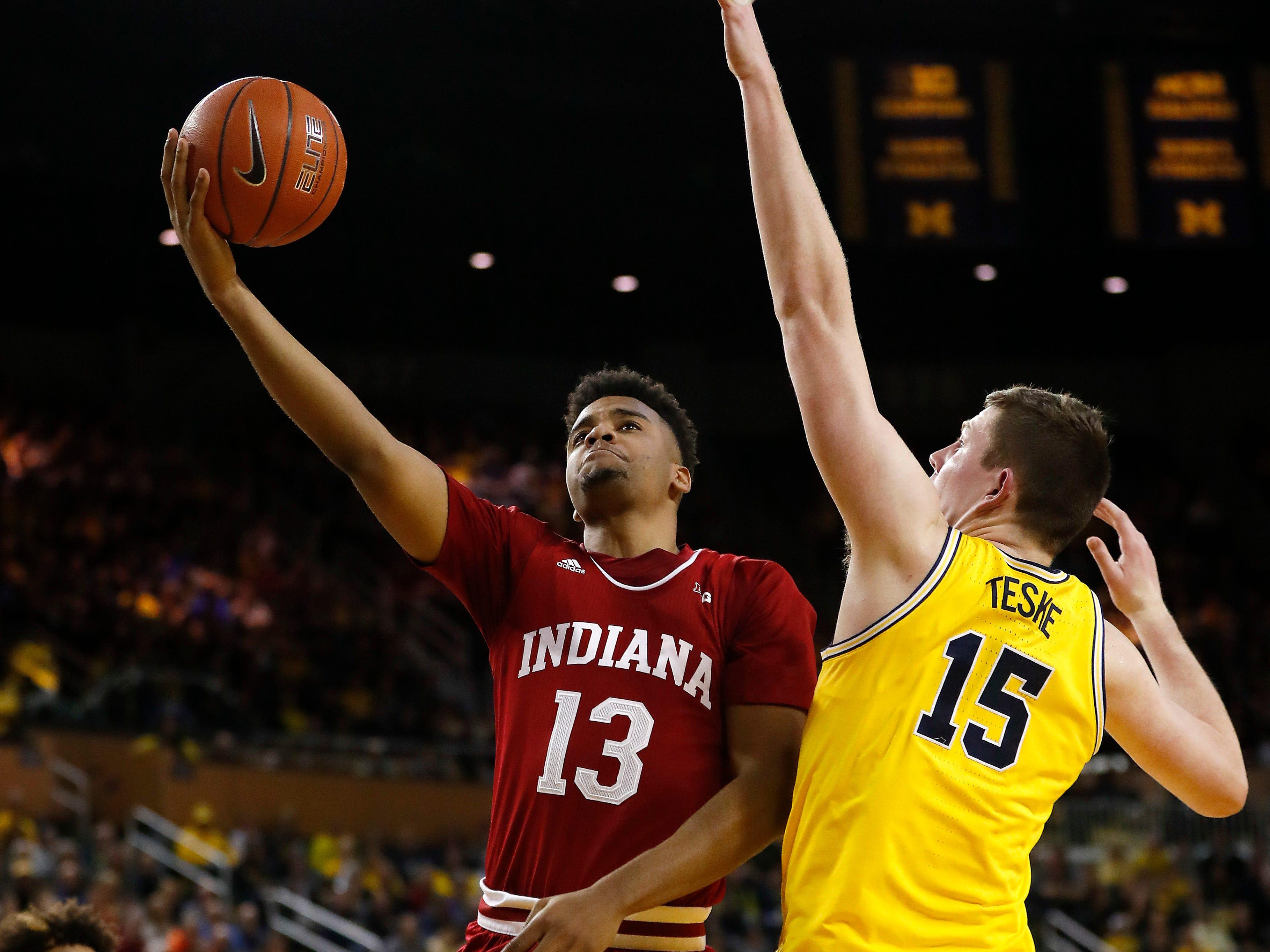 Indiana forward Juwan Morgan (13) shoots on Michigan center Jon Teske (15) in the first half of an NCAA college basketball game in Ann Arbor, Mich., Sunday, Jan. 6, 2019.