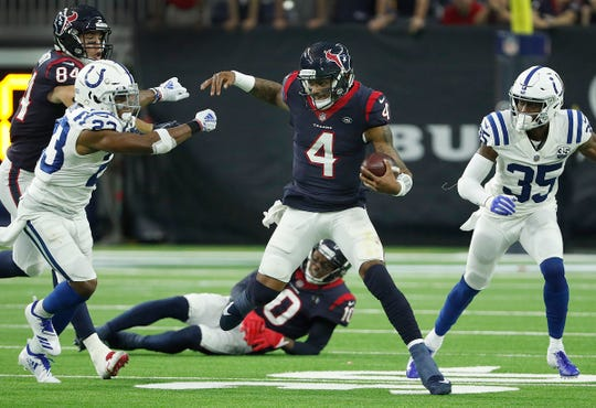Kenny Moore (23) chased down Houston Texans quarterback Deshaun Watson during their AFC Wild Card playoff game at NRG Stadium in Houston, Texas, on Jan. 5, 2019.