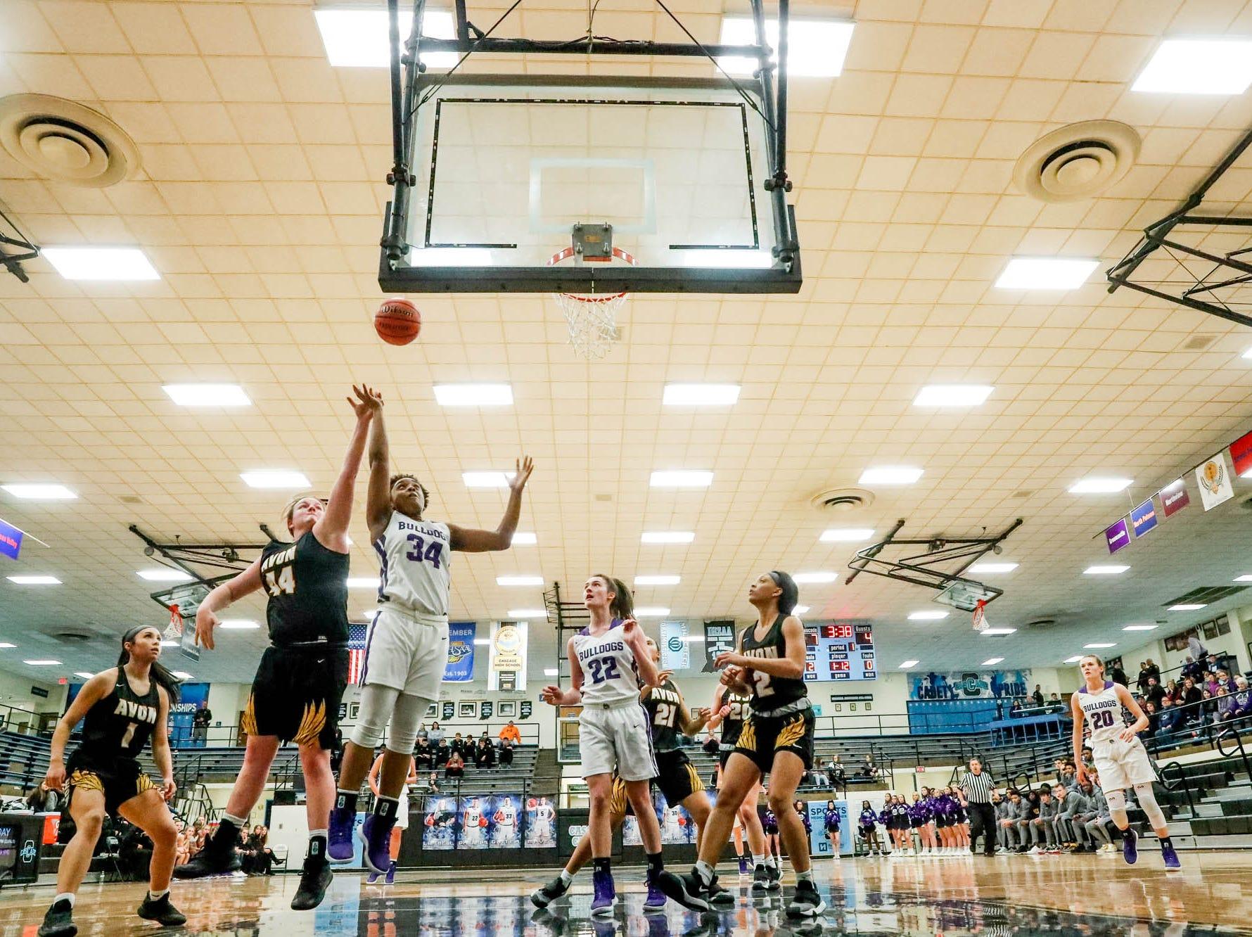 Avon High School's Haley Nichols (44), tries to block a shot by Brownsburg High School's Aminah Thomas (34), during the 2019 Hendricks County Basketball Tournament game between the Avon High School girls varsity basketball team and Brownsburg High School, held at Cascade High School on Saturday, Jan. 5, 2019. The final score was 69-44.