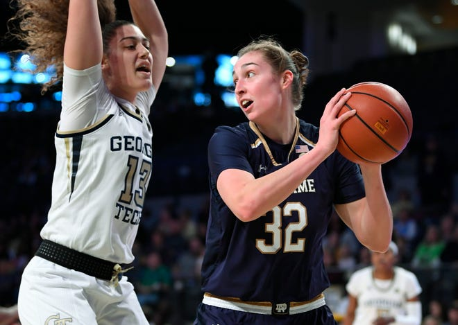 Notre Dame forward Jessica Shepard, right, snags a rebound as Georgia Tech forward Lorela Cubaj, left, defends during the first half of an NCAA college basketball game, Sunday, Jan. 6, 2019, in Atlanta.