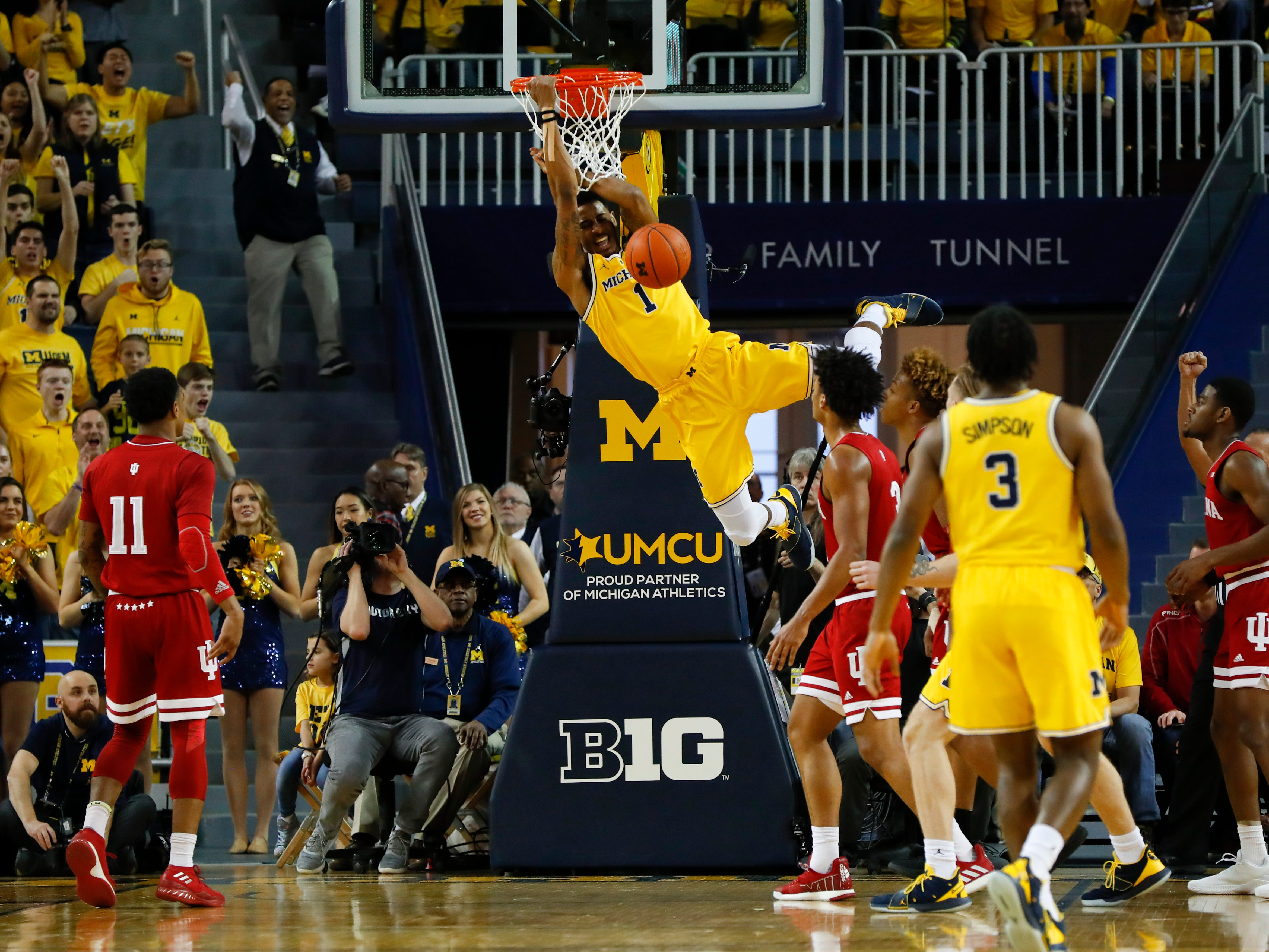 Michigan guard Charles Matthews (1) dunks in the first half of an NCAA college basketball game against Indiana in Ann Arbor, Mich., Sunday, Jan. 6, 2019.