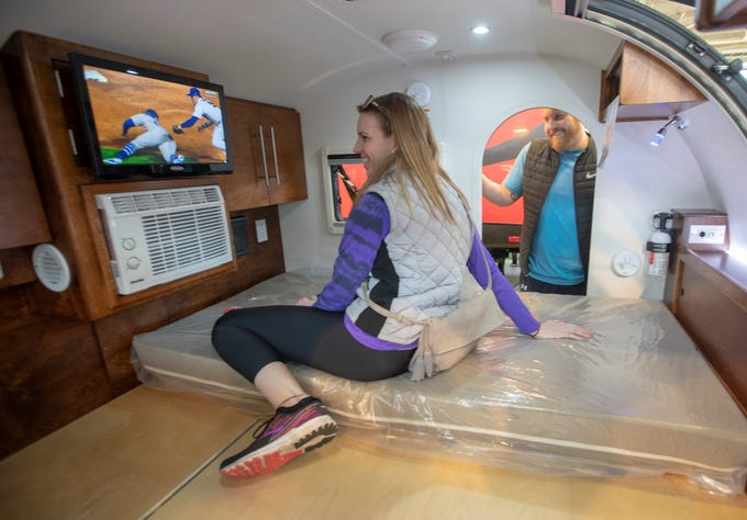 Betsy Bradley and Patrick Williams, both of Indianapolis, take a look at a small unit at the Indy RV Expo, Indiana State Fairgrounds, Indianapolis, Sunday, January 6, 2019. The show runs through the 13th.