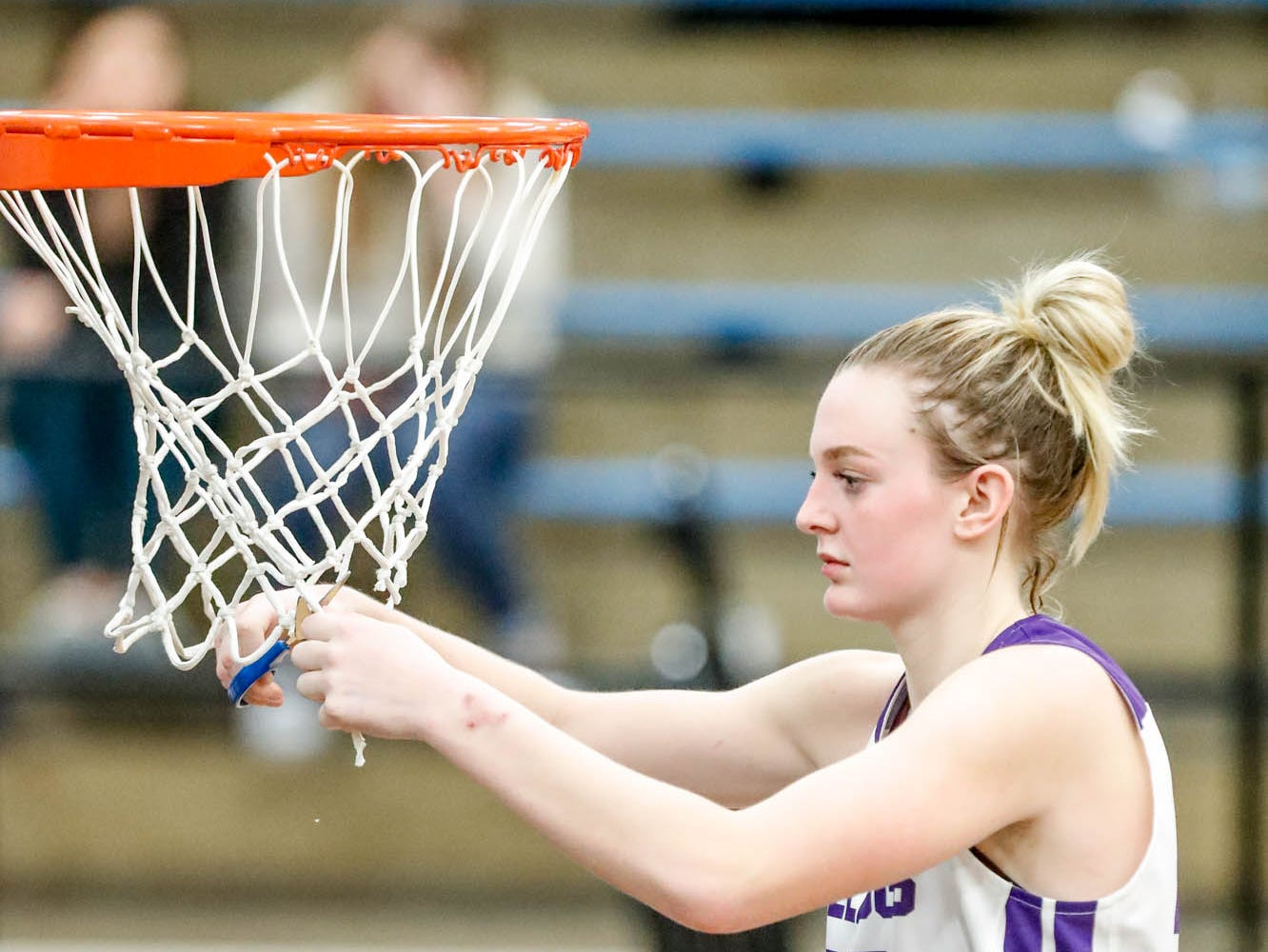 Brownsburg High School's forward Mackenzie Stien (44), cuts pieces from the net after winning the 2019 Hendricks County Basketball Tournament game between the Avon High School girls varsity basketball team and Brownsburg High School, held at Cascade High School on Saturday, Jan. 5, 2019. The final score was 69-44.