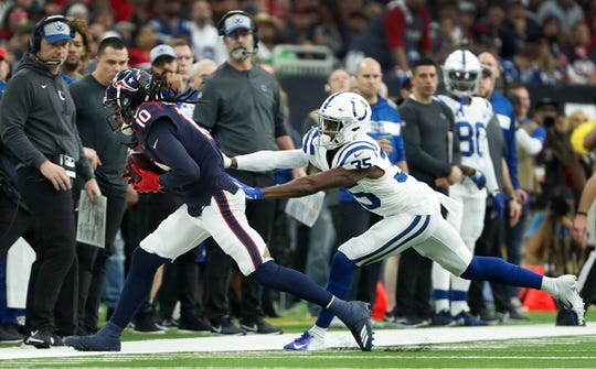 Indianapolis Colts cornerback Pierre Desir (35) pushes Houston Texans wide receiver DeAndre Hopkins (10) out of bounds during their AFC Wild Card playoff game at NRG Stadium in Houston, TX., on Saturday, Jan. 5, 2019.