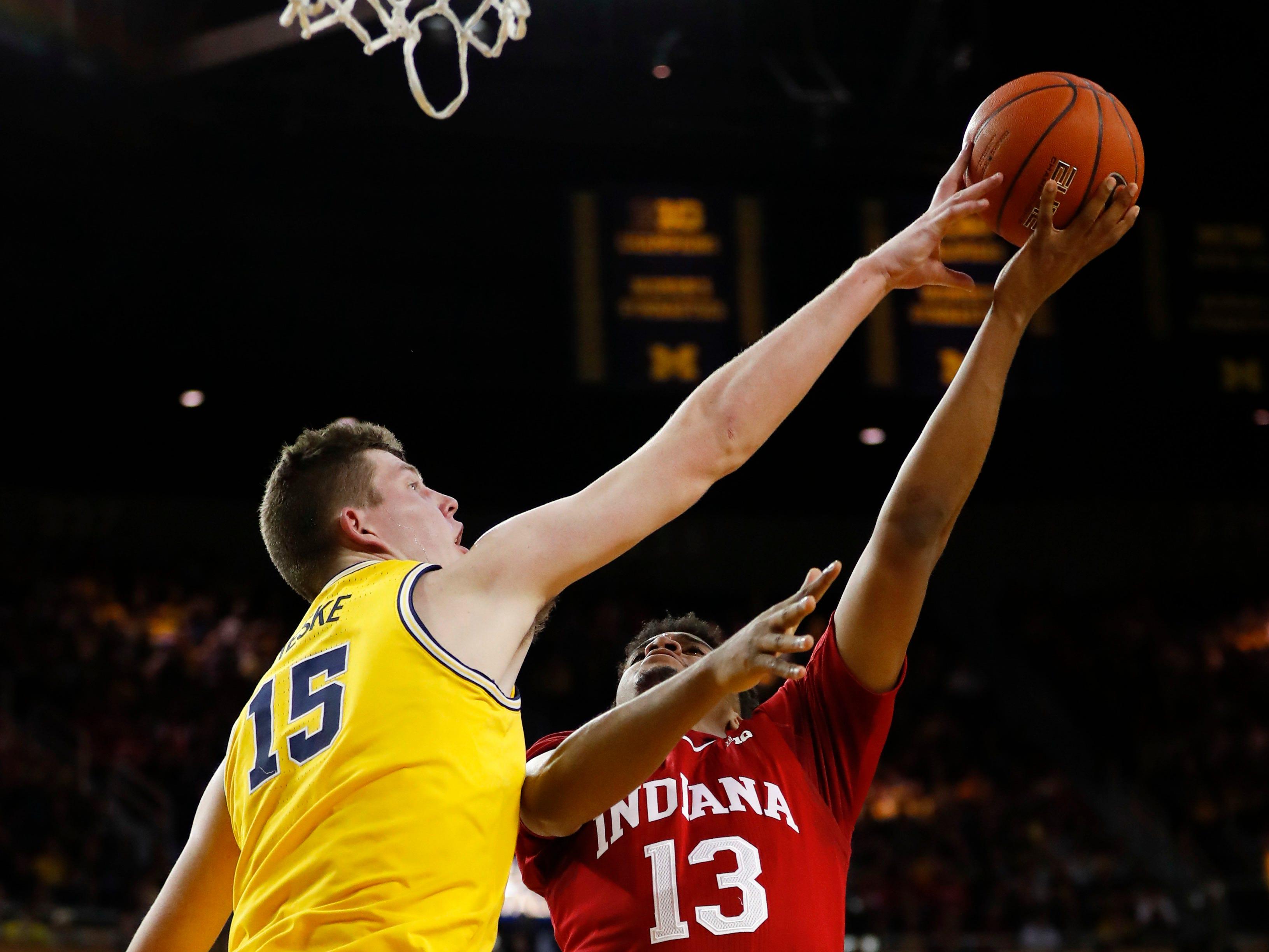 Michigan center Jon Teske (15) blocks a Indiana forward Juwan Morgan (13) shot in the first half.