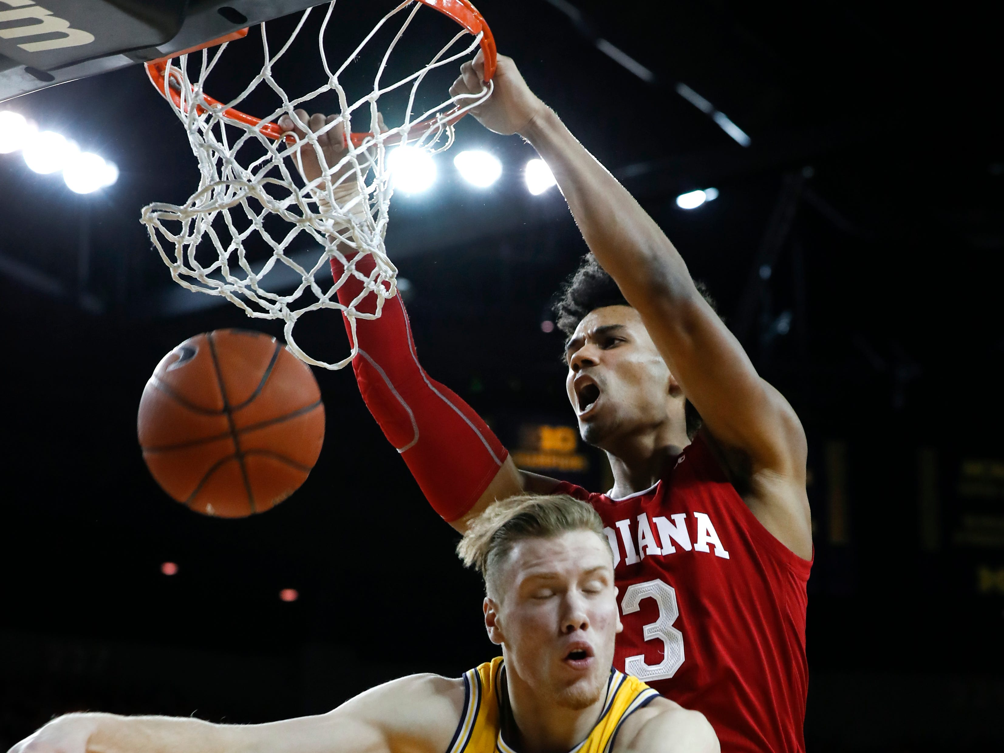 Indiana forward Justin Smith (3) dunks on Michigan forward Ignas Brazdeikis (13) in the first half of an NCAA college basketball game in Ann Arbor, Mich., Sunday, Jan. 6, 2019.