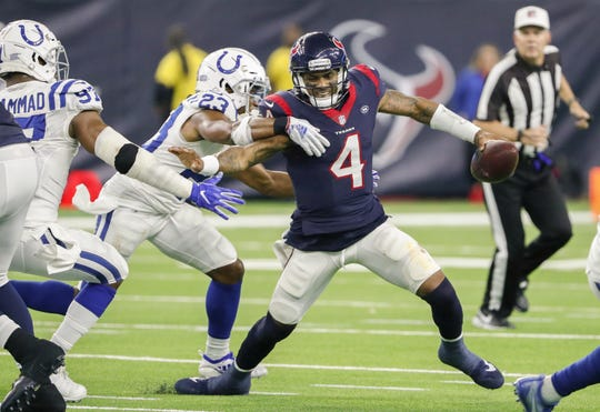 Indianapolis Colts cornerback Kenny Moore (23) grabs onto Houston Texans quarterback Deshaun Watson (4) during the second half of an NFL Wild Card Round playoff game, Saturday, Jan. 5, 2019 at NRG Stadium in Houston, Texas.