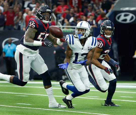 Indianapolis Colts wide receiver T.Y. Hilton (13) makes a catch as he is defended by Houston Texans strong safety Justin Reid (20) and Benardrick McKinney (55) in the first half of their AFC Wild Card playoff game at NRG Stadium in Houston, TX., on Saturday, Jan. 5, 2019.