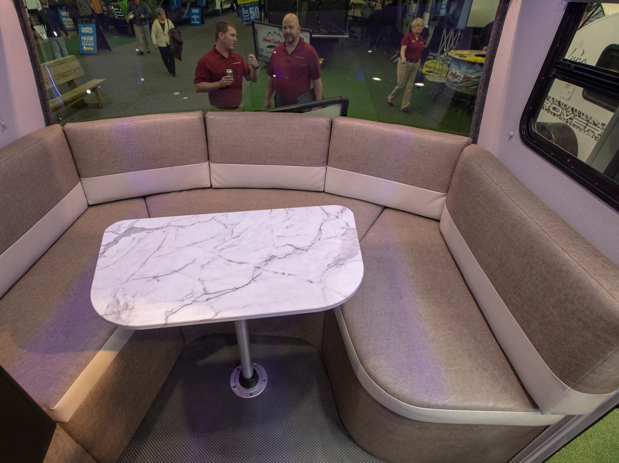 Seating area of the 2019 Intech Sol, complete with a lot of modern touches like blue accent lights and a futuristic front end, at the Indy RV Expo, Indiana State Fairgrounds, Indianapolis, Sunday, January 6, 2019. The show runs through the 13th.