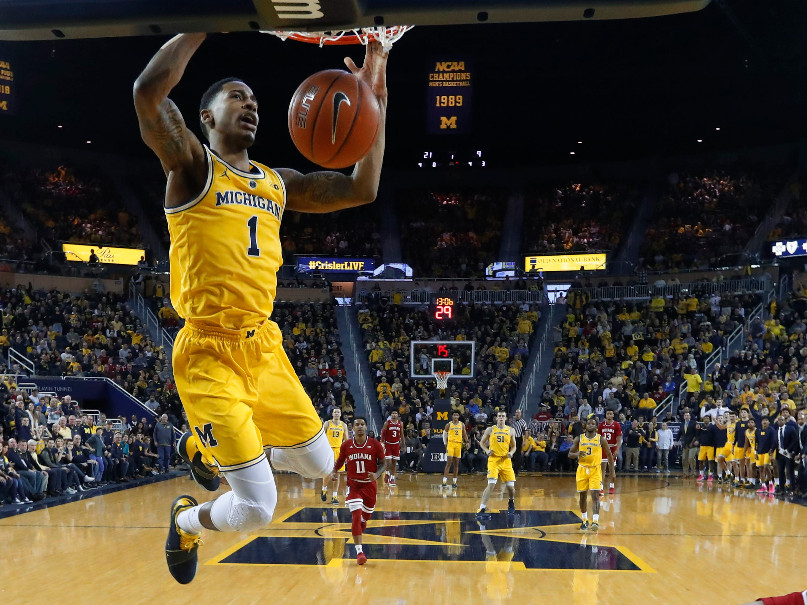 Michigan guard Charles Matthews dunks in the first half of an NCAA college basketball game against Indiana in Ann Arbor, Mich., Sunday, Jan. 6, 2019.
