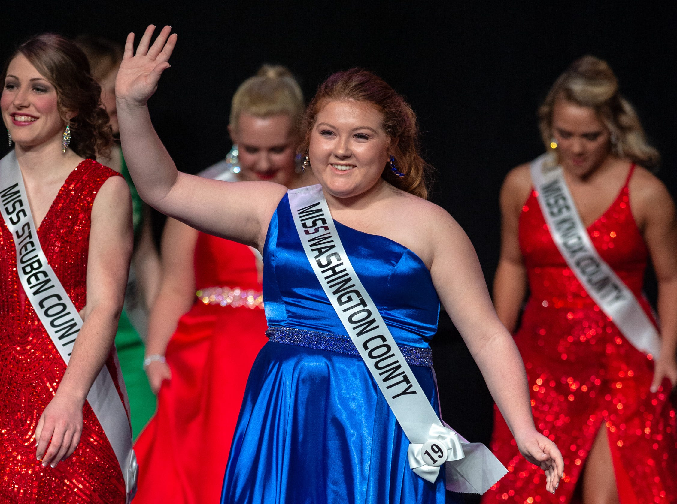 Miss Washington County, Kayla Rose, waves to the audience as she leaves the stage during the 61st Indiana State Fair Queen Pageant at the Indiana State Fairgrounds in Indianapolis on Sunday, Jan. 6, 2019.