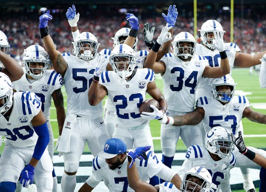Colts cornerback Kenny Moore (23) and his teammates celebrate his interception in the wild-card playoff win over the Texans.