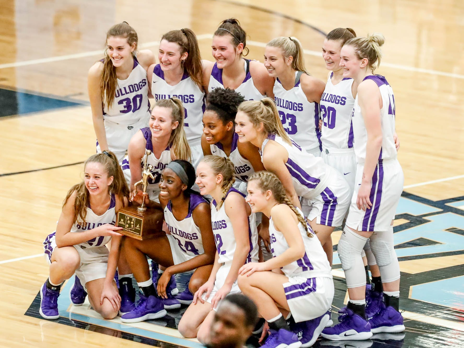 The Brownsburg girls varsity team pose for photos after winning the 2019 Hendricks County Basketball Tournament game between the Avon High School girls varsity basketball team and Brownsburg High School, held at Cascade High School on Saturday, Jan. 5, 2019. The final score was 69-44.