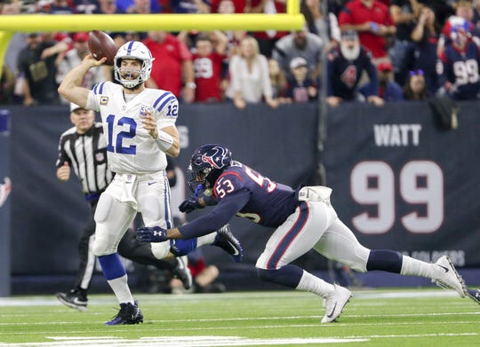 Houston Texans linebacker Duke Ejiofor (53) pressures Indianapolis Colts quarterback Andrew Luck (12) as he passes during the second half of an NFL Wild Card Round playoff game.