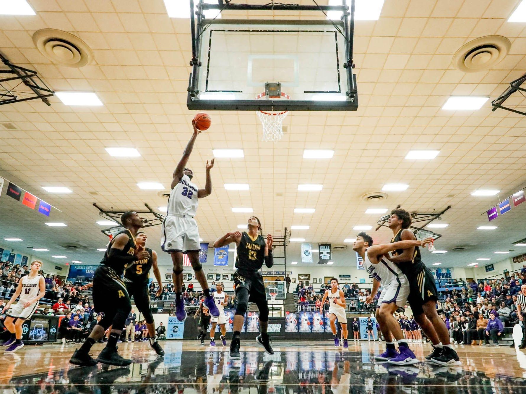 Brownsburg High School's Malek Edmonds (32) shoots a layup during the 2019 Hendricks County Basketball Tournament game between the Avon High School boys varsity basketball team and Brownsburg High School, held at Cascade High School on Saturday, Jan. 5, 2019.