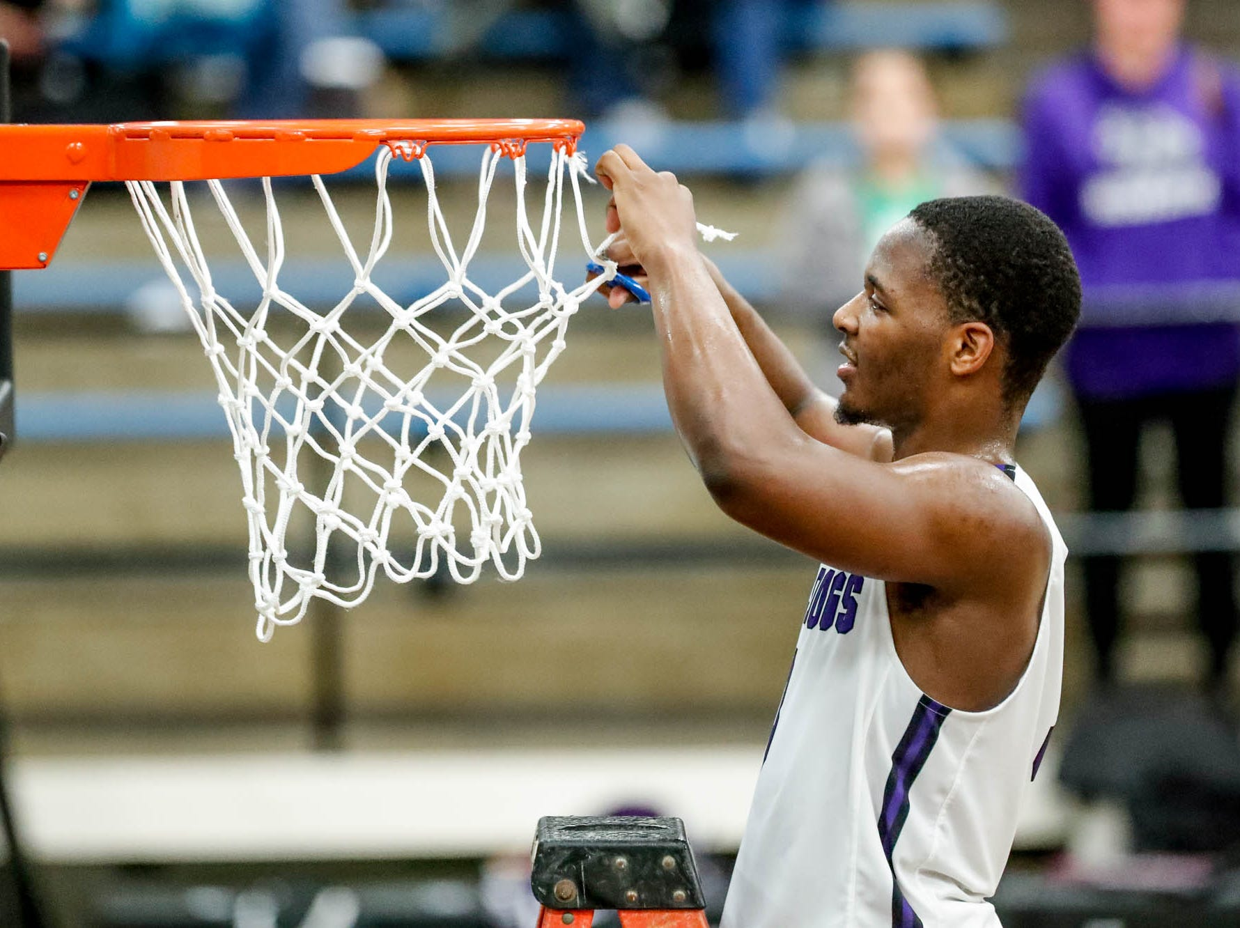 Brownsburg High School's guard Cameron Alford (3), cuts pieces of the net after winning the 2019 Hendricks County Basketball Tournament game between the Avon High School boys varsity basketball team and Brownsburg High School, held at Cascade High School on Saturday, Jan. 5, 2019.