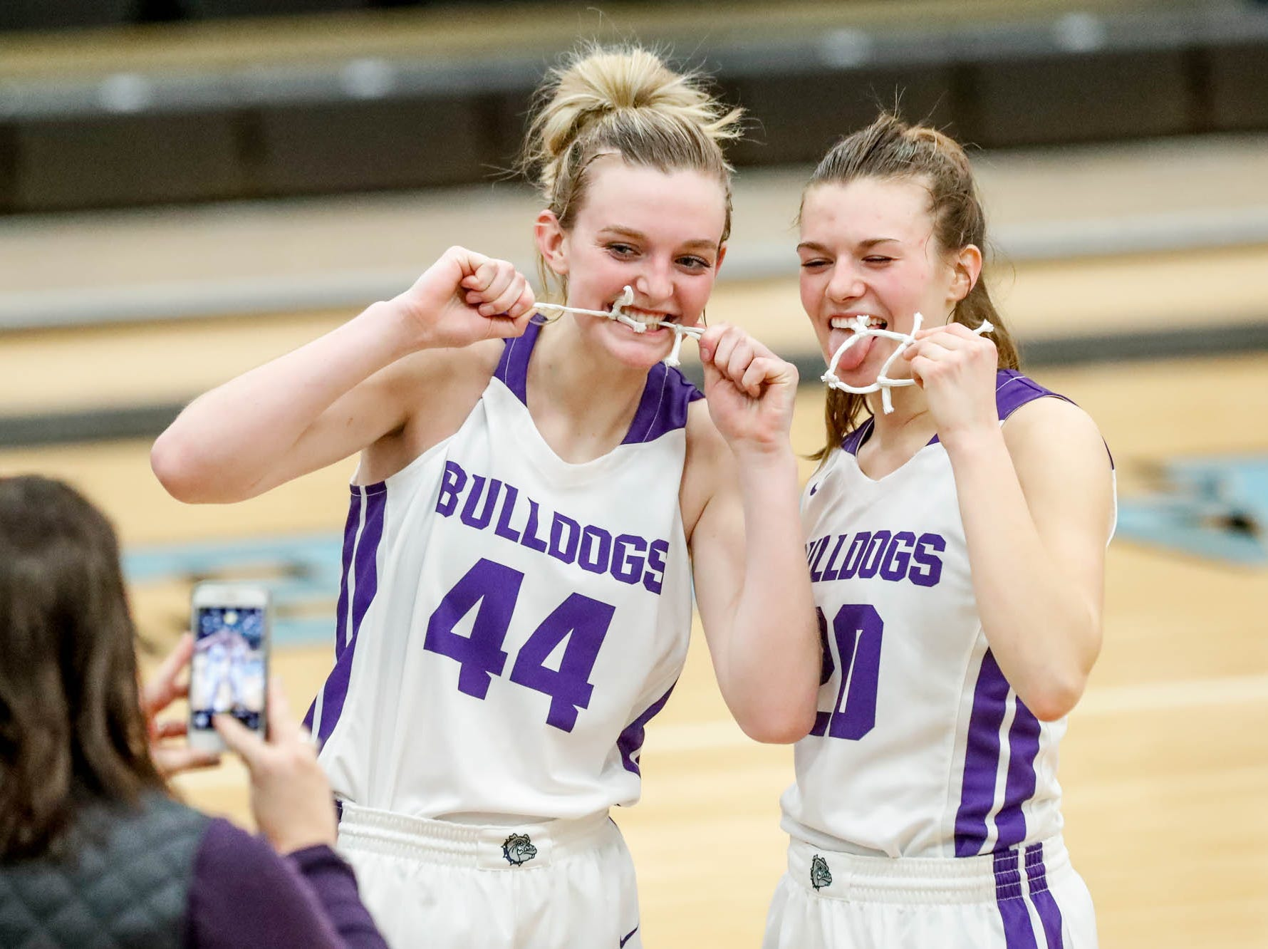 Brownsburg High School's forward Mackenzie Stien (44), and Brownsburg High School's guard Allison Bosse (20), pose for photos with pieces of the net afterwinning the 2019 Hendricks County Basketball Tournament game between the Avon High School girls varsity basketball team and Brownsburg High School, held at Cascade High School on Saturday, Jan. 5, 2019. The final score was 69-44.