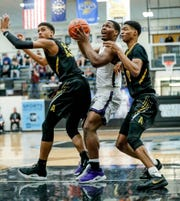 Avon High School's Jayden Baylor (13), and Jayden Brewer (12), double team Brownsburg High School's guard Cameron Alford (3), during the 2019 Hendricks County Basketball Tournament game between the Avon High School boys varsity basketball team and Brownsburg High School, held at Cascade High School on Saturday, Jan. 5, 2019.