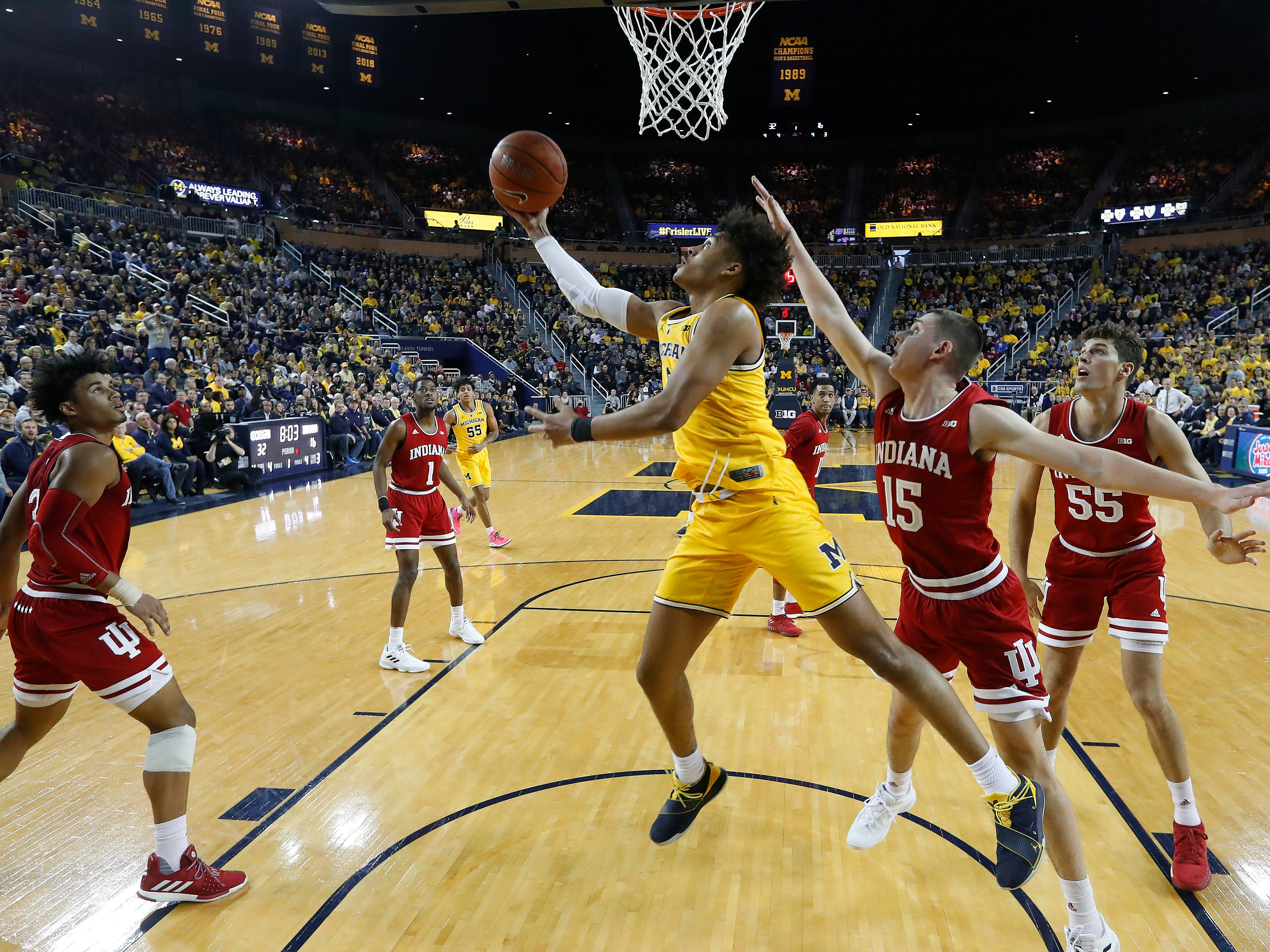 Michigan guard Jordan Poole (2) drives against Indiana in the first half of an NCAA college basketball game in Ann Arbor, Mich., Sunday, Jan. 6, 2019.