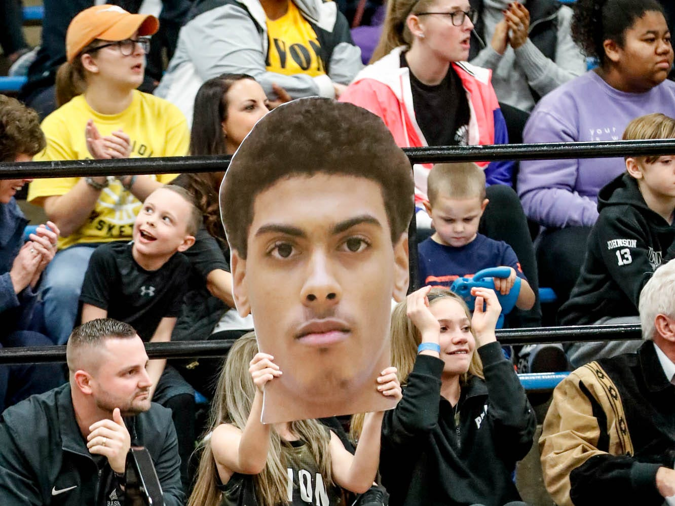 A fan holds a photo during the 2019 Hendricks County Basketball Tournament game between the Avon High School boys varsity basketball team and Brownsburg High School, held at Cascade High School on Saturday, Jan. 5, 2019.