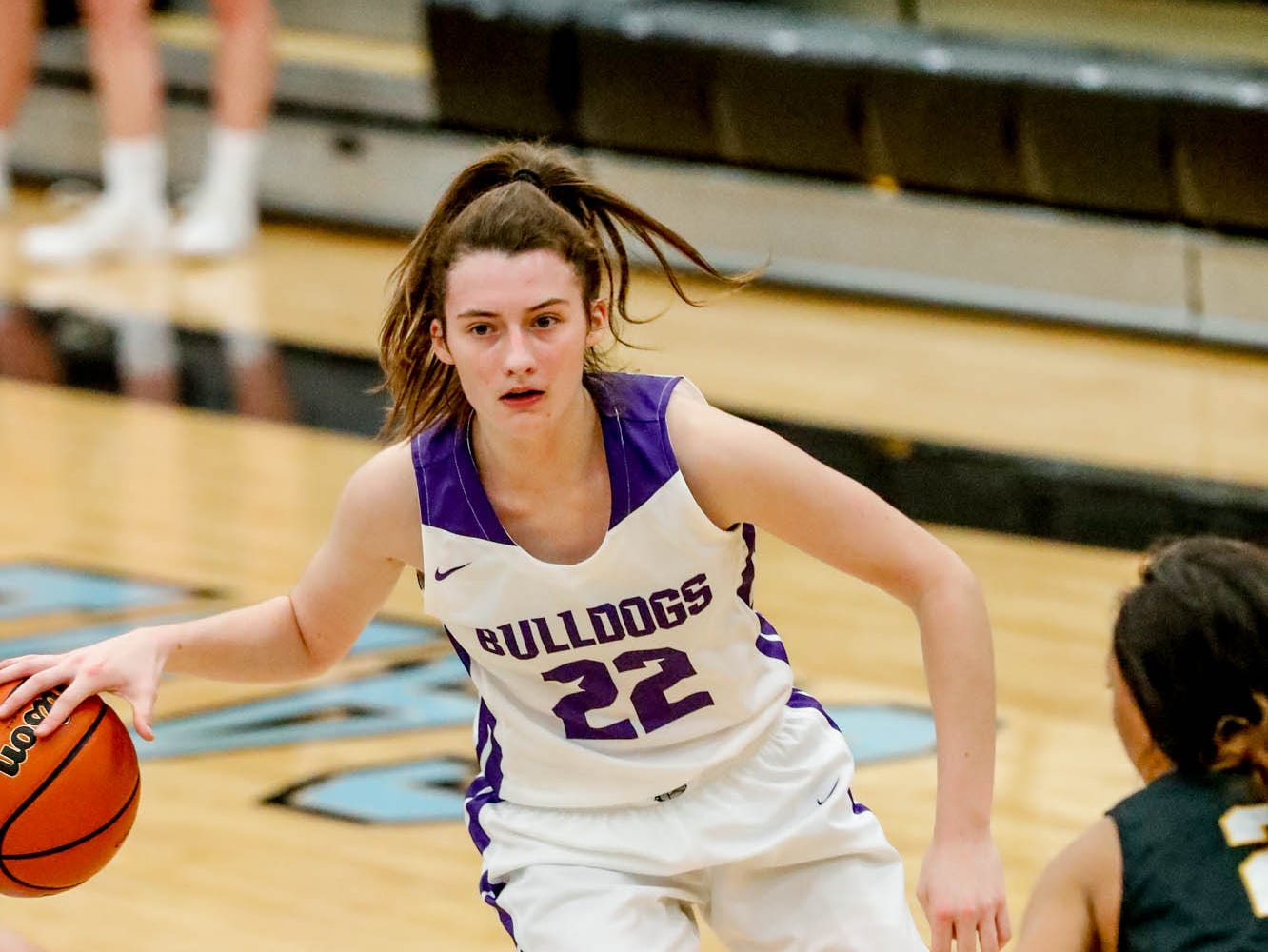 Brownsburg High School's guard Ally Becki (22), looks for a hole in Avons defense during a 2019 Hendricks County Basketball Tournament game between the Avon High School girls varsity basketball team and Brownsburg High School, held at Cascade High School on Saturday, Jan. 5, 2019.