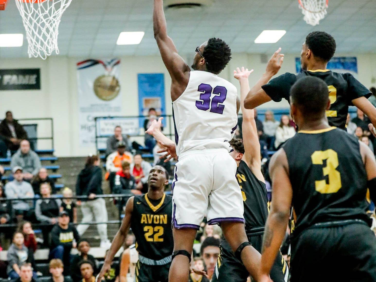 Brownsburg High School's Malek Edmonds (32) shoots afor the hoop during the 2019 Hendricks County Basketball Tournament game between the Avon High School boys varsity basketball team and Brownsburg High School, held at Cascade High School on Saturday, Jan. 5, 2019.
