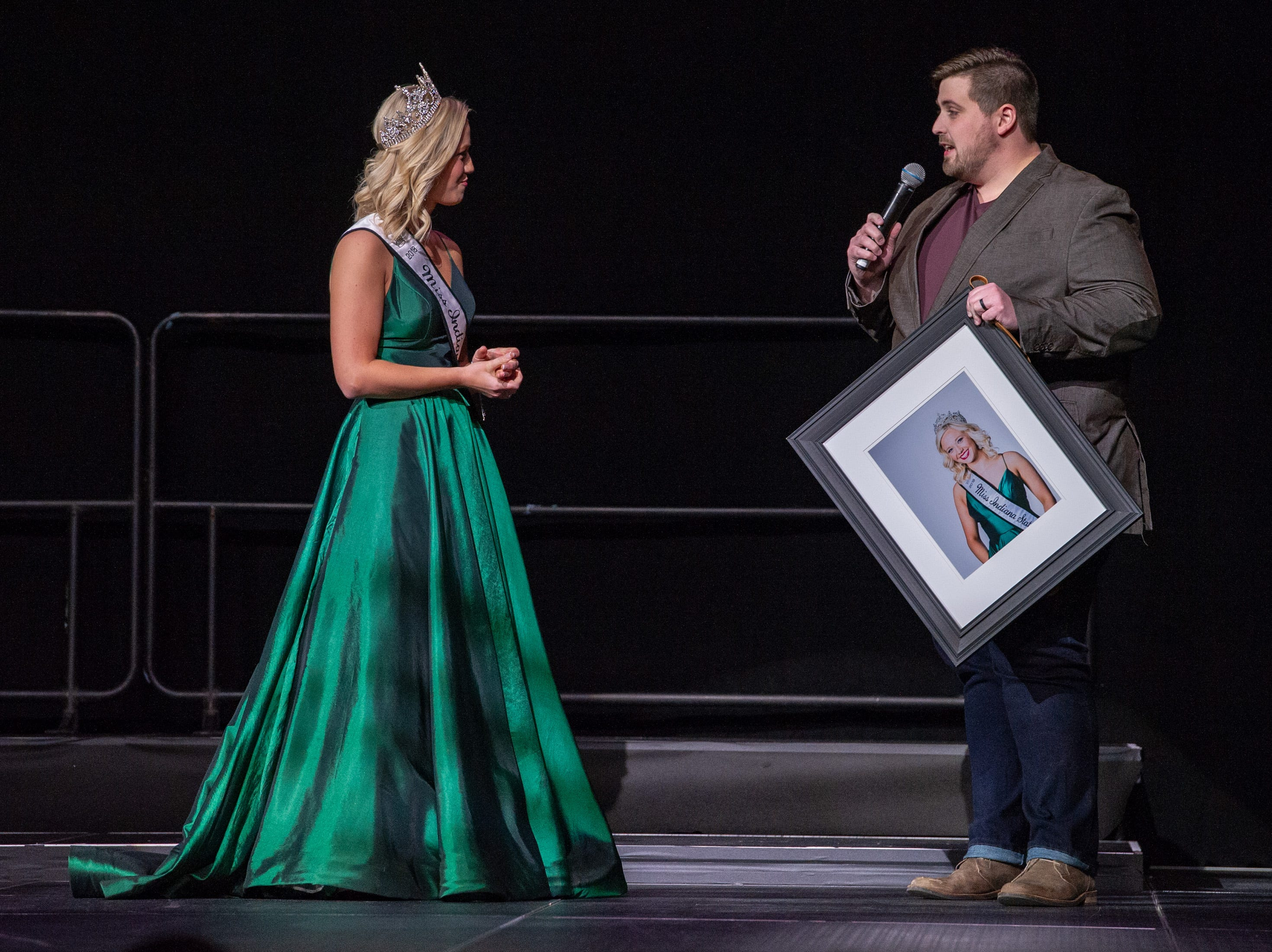 Miss Indiana State Fair 2018, Audrey Campbell, was presented with a portrait of herself during the 61st Indiana State Fair Queen Pageant at the Indiana State Fairgrounds in Indianapolis on Sunday, Jan. 6, 2019.