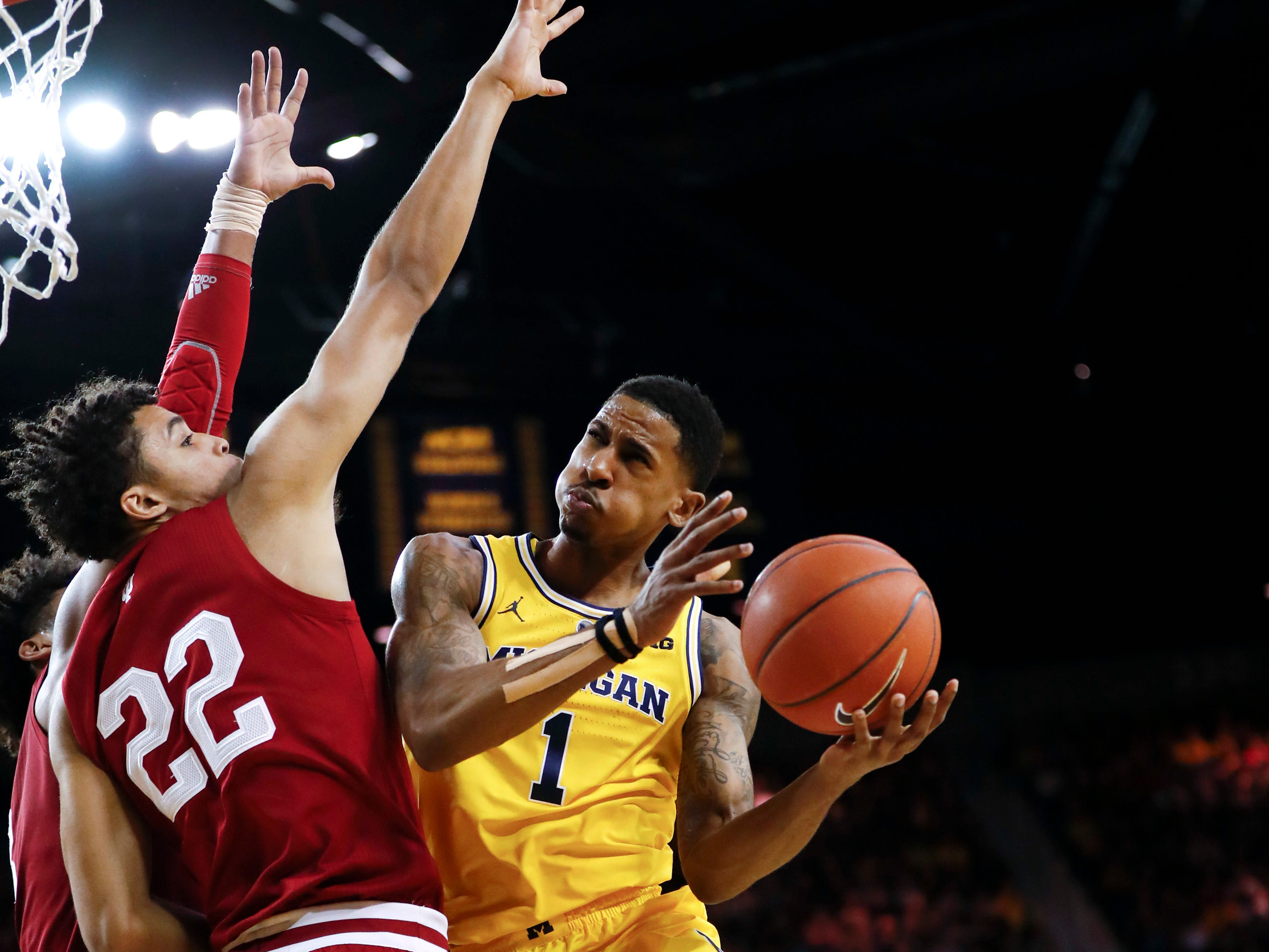 Michigan guard Charles Matthews (1) drives on Indiana forward Clifton Moore (22) in the second half of an NCAA college basketball game in Ann Arbor, Mich., Sunday, Jan. 6, 2019.