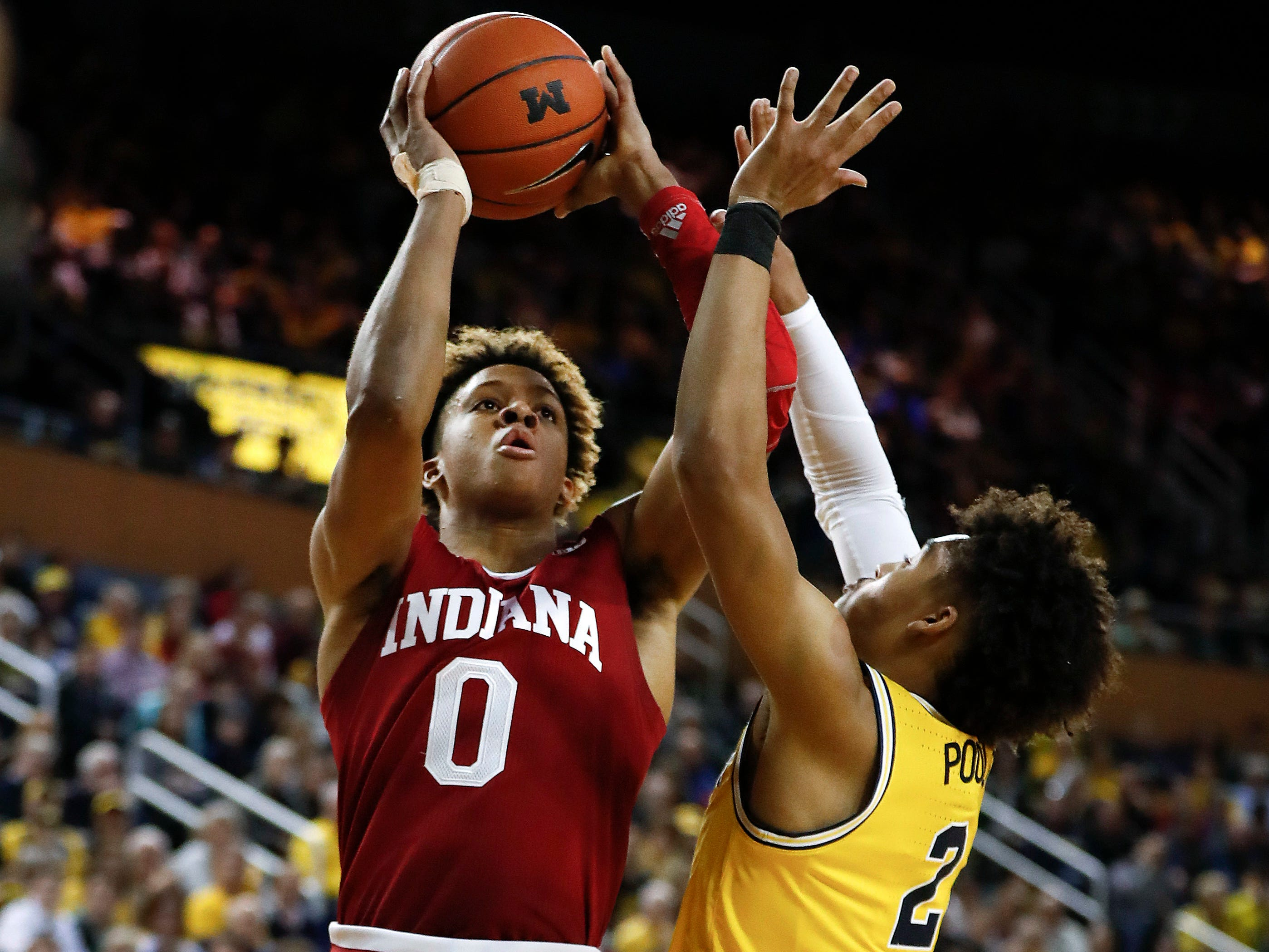 Indiana guard Romeo Langford (0) shoots on Michigan guard Jordan Poole (2) in the first half of an NCAA college basketball game in Ann Arbor, Mich., Sunday, Jan. 6, 2019.