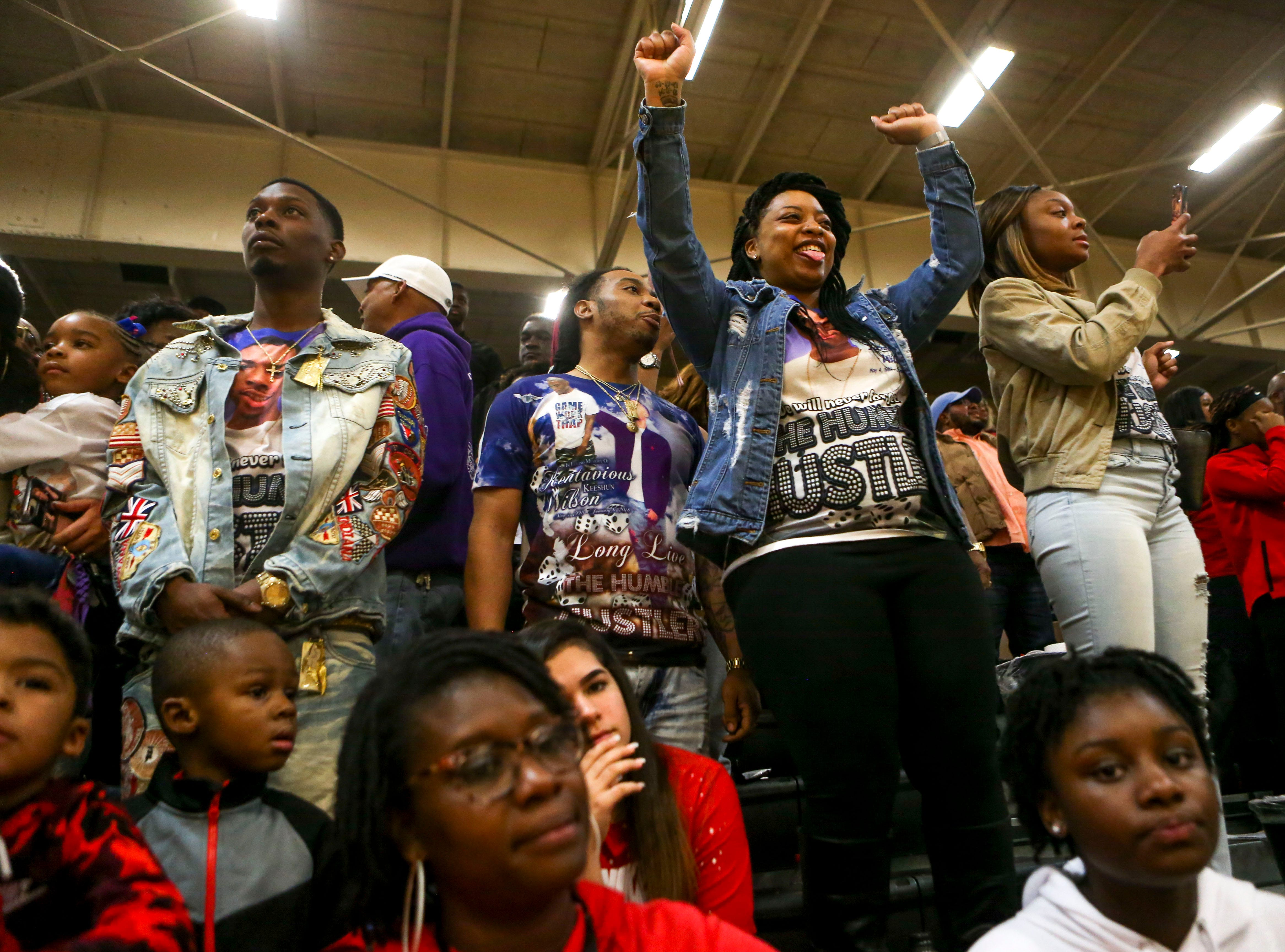 Friends and family celebrate Haywood's victory during a TSSAA basketball game between South Side and Haywood on the anniversary of Kentavious Wilson, a former Haywood player's, death at South Side High School in Jackson, Tenn., on Saturday, Jan. 5, 2019.