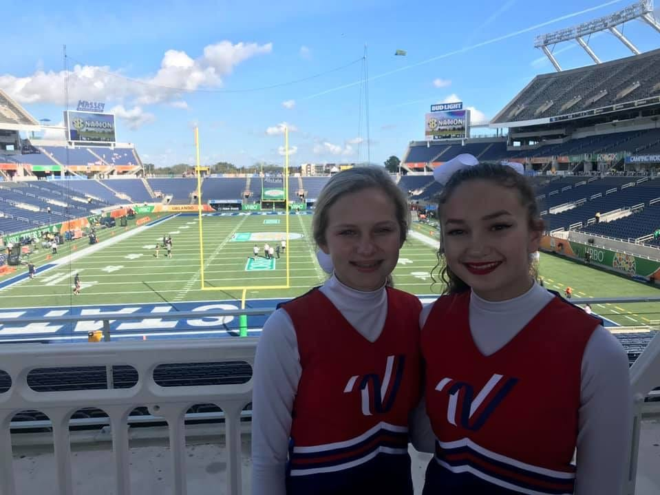 Meredith Lambert and Kaitlyn Mullins stand in the bleachers before the Citrus Bowl pre-game show at the Camping World Stadium in Orlando, Florida.
