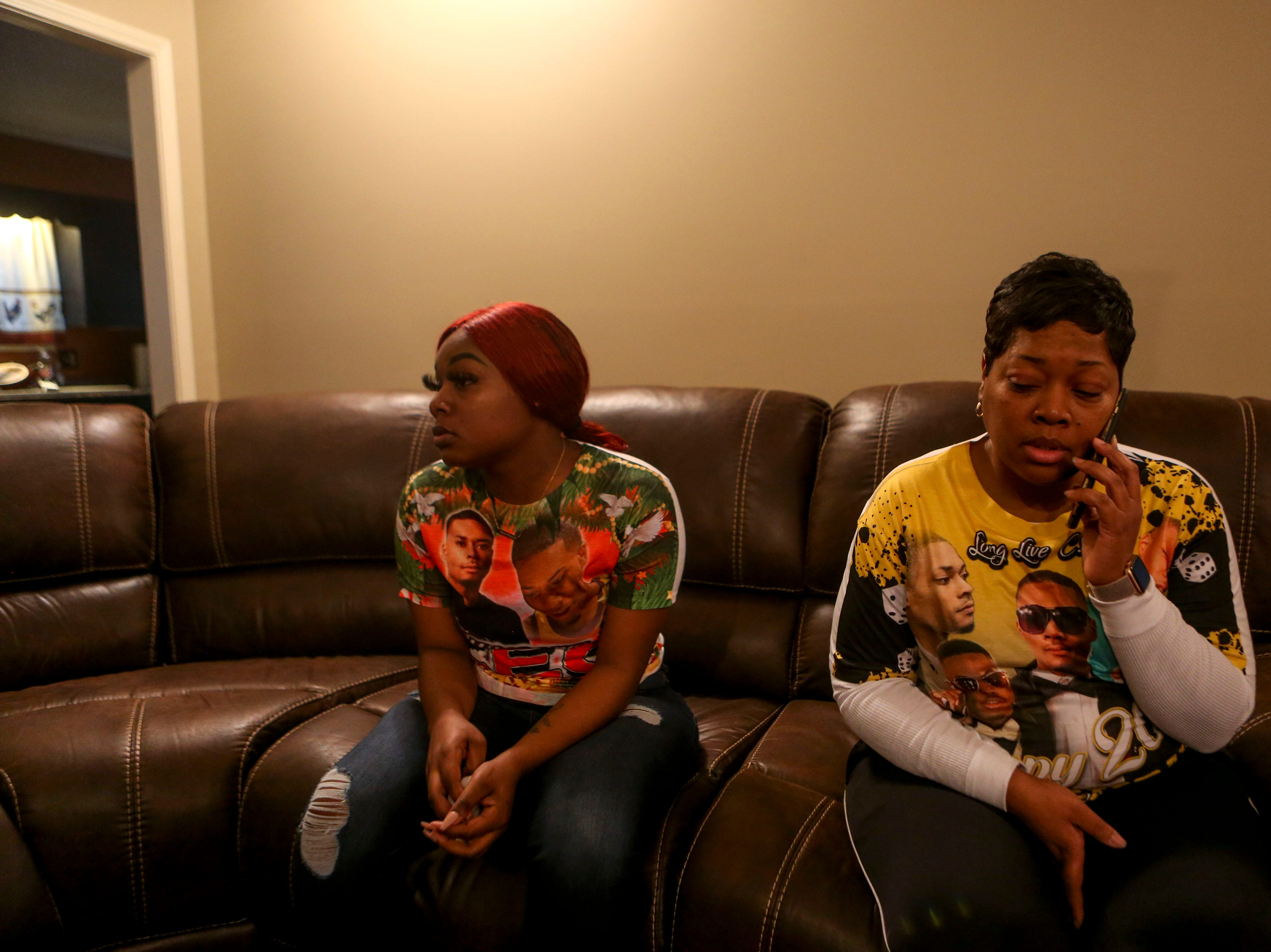 Kemmeka Currie, right, Kentavious Wilson's mother, and Keyshia Pruitt, left, Wilson's former girlfriend, sit on a couch while chatting about Wilson at the Currie's home in Brownsville, Tenn., on Wednesday, Jan. 2, 2019.