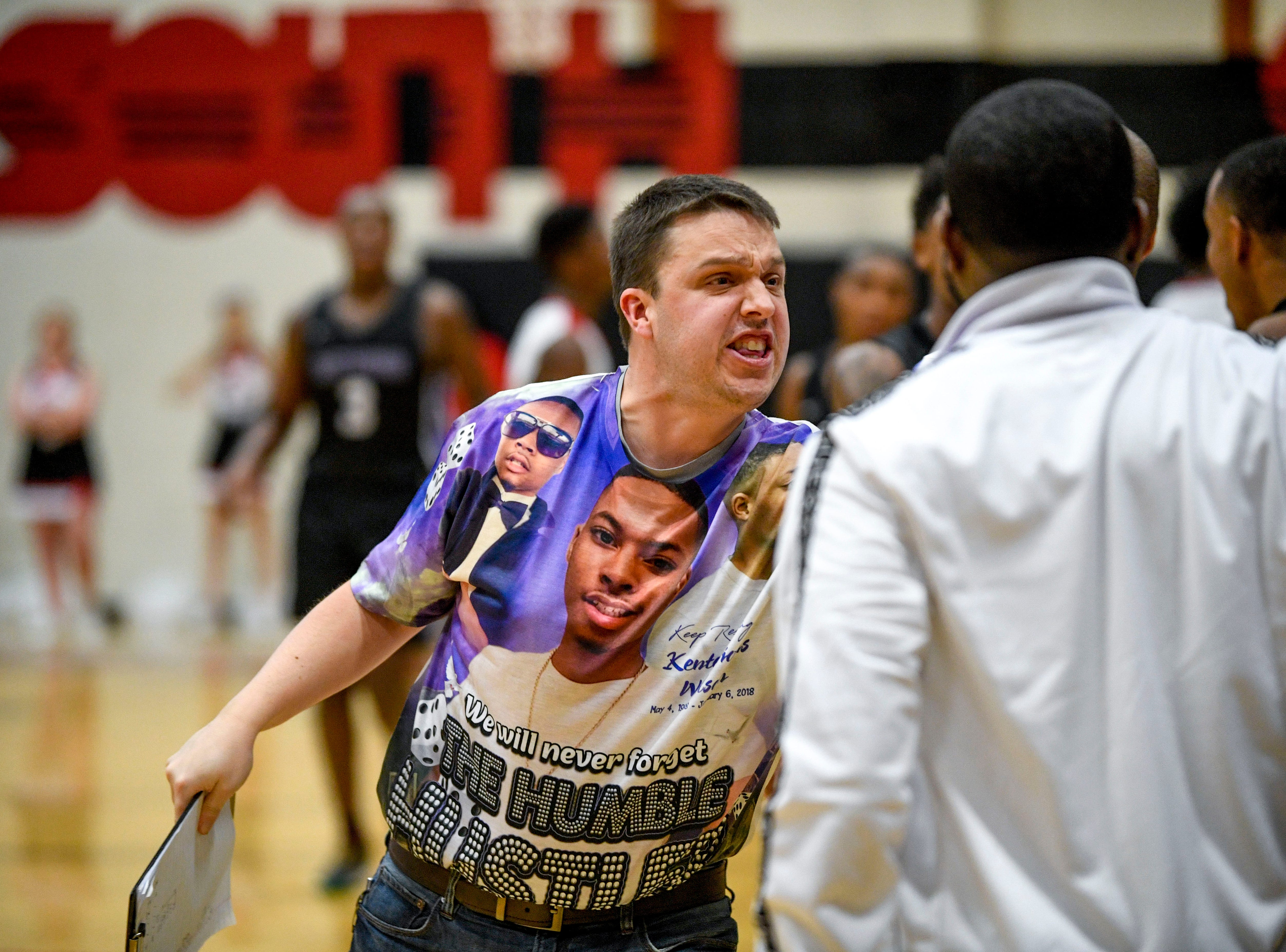 A Haywood assistant coach, wearing a special memorial t-shirt for Kentavious Wilson, yells to his players during a TSSAA basketball game between South Side and Haywood on the anniversary of Wilson, a former Haywood player's, death at South Side High School in Jackson, Tenn., on Saturday, Jan. 5, 2019.