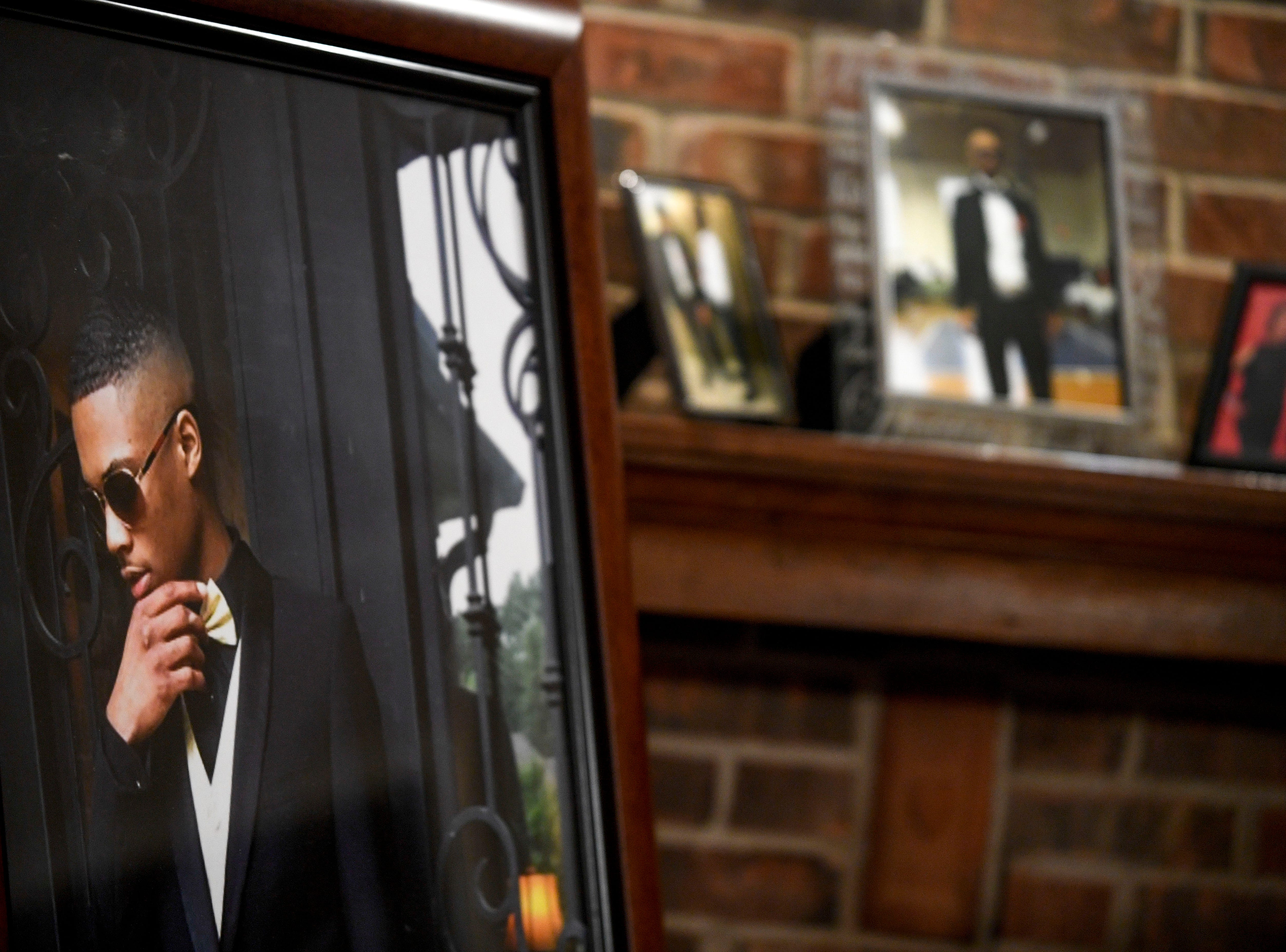 Kemmeka Currie took a photo from Kentavious Wilson's prom, blew it up, and framed it to honor her deceased son at the Currie's home in Brownsville, Tenn., on Wednesday, Jan. 2, 2019.