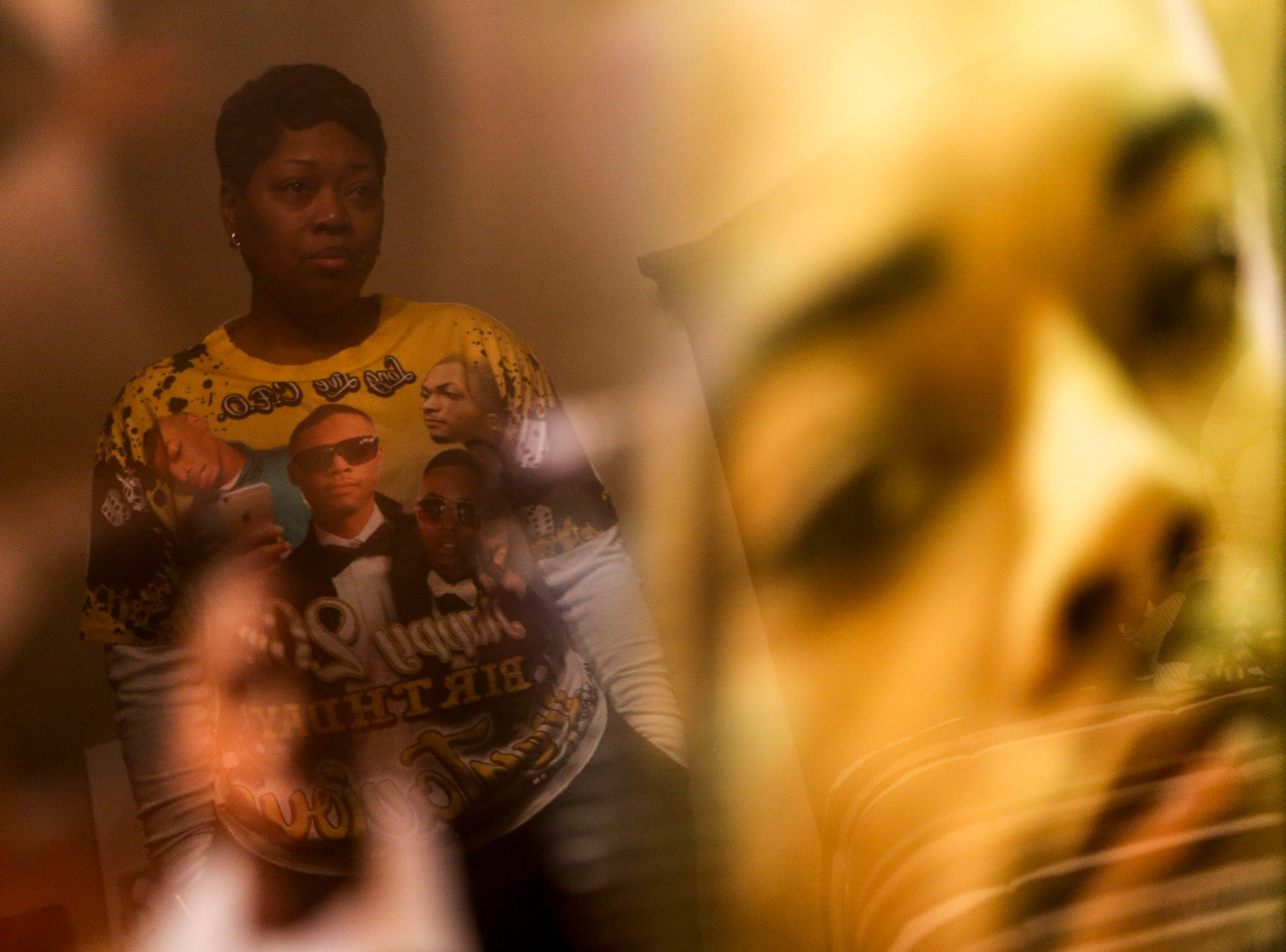 Kemmeka Currie looks on at photos of her son, Kentavious Wilson, who was killed last January a few minutes from her home at the Currie's home in Brownsville, Tenn., on Wednesday, Jan. 2, 2019.