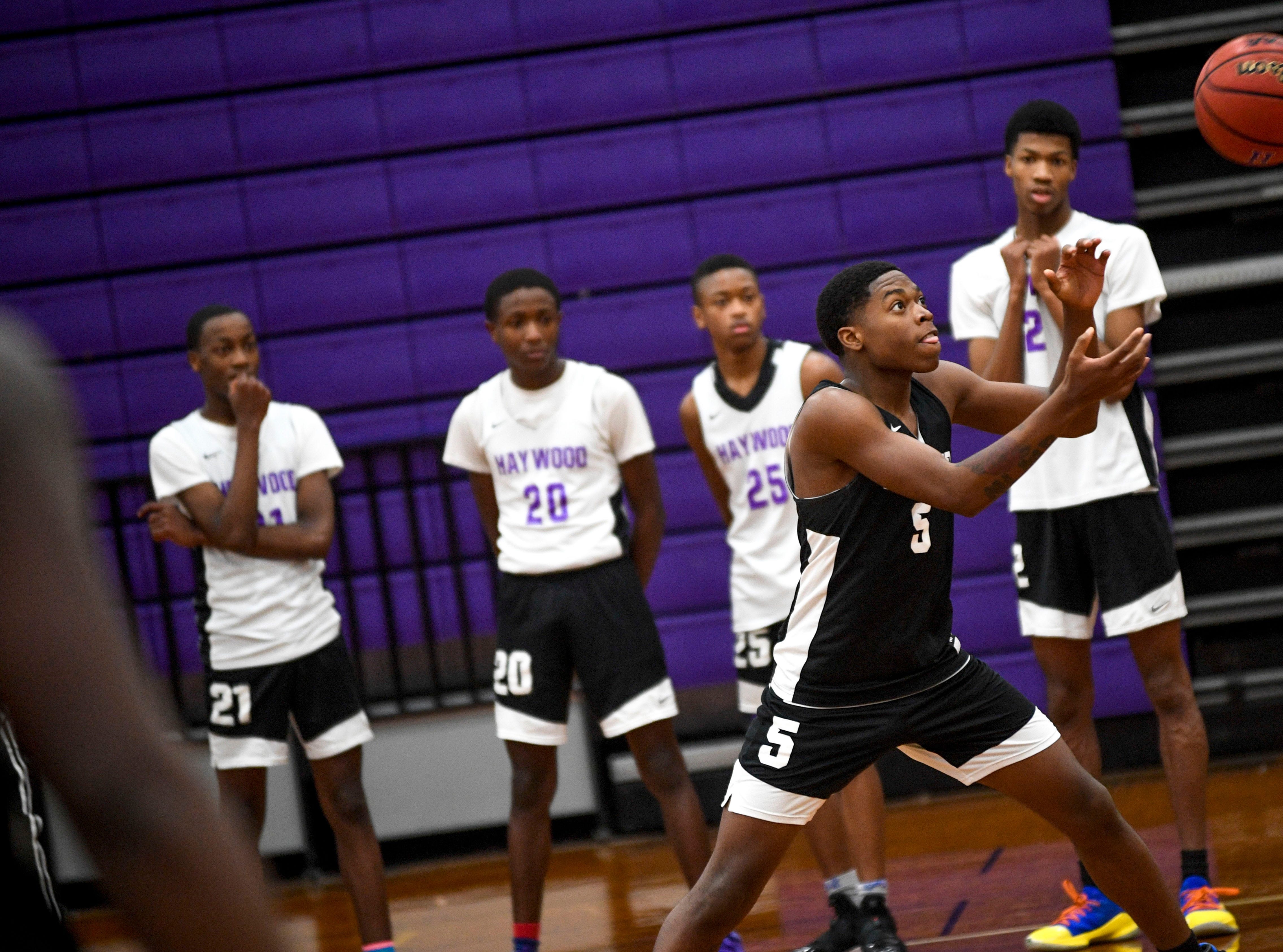 Kyron Stocking reaches to catch a pass in a drill during basketball practice at Haywood High School in Brownsville, Tenn., on Wednesday, Jan. 2, 2019.