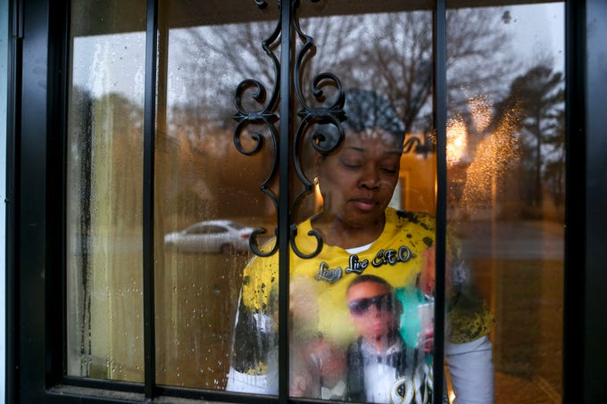 Kemmeka Wilson stands in her doorway wearing a shirt made in remembrance of her son Kentavious Wilson at the Currie's home in Brownsville, Tenn., on Wednesday, Jan. 2, 2019.