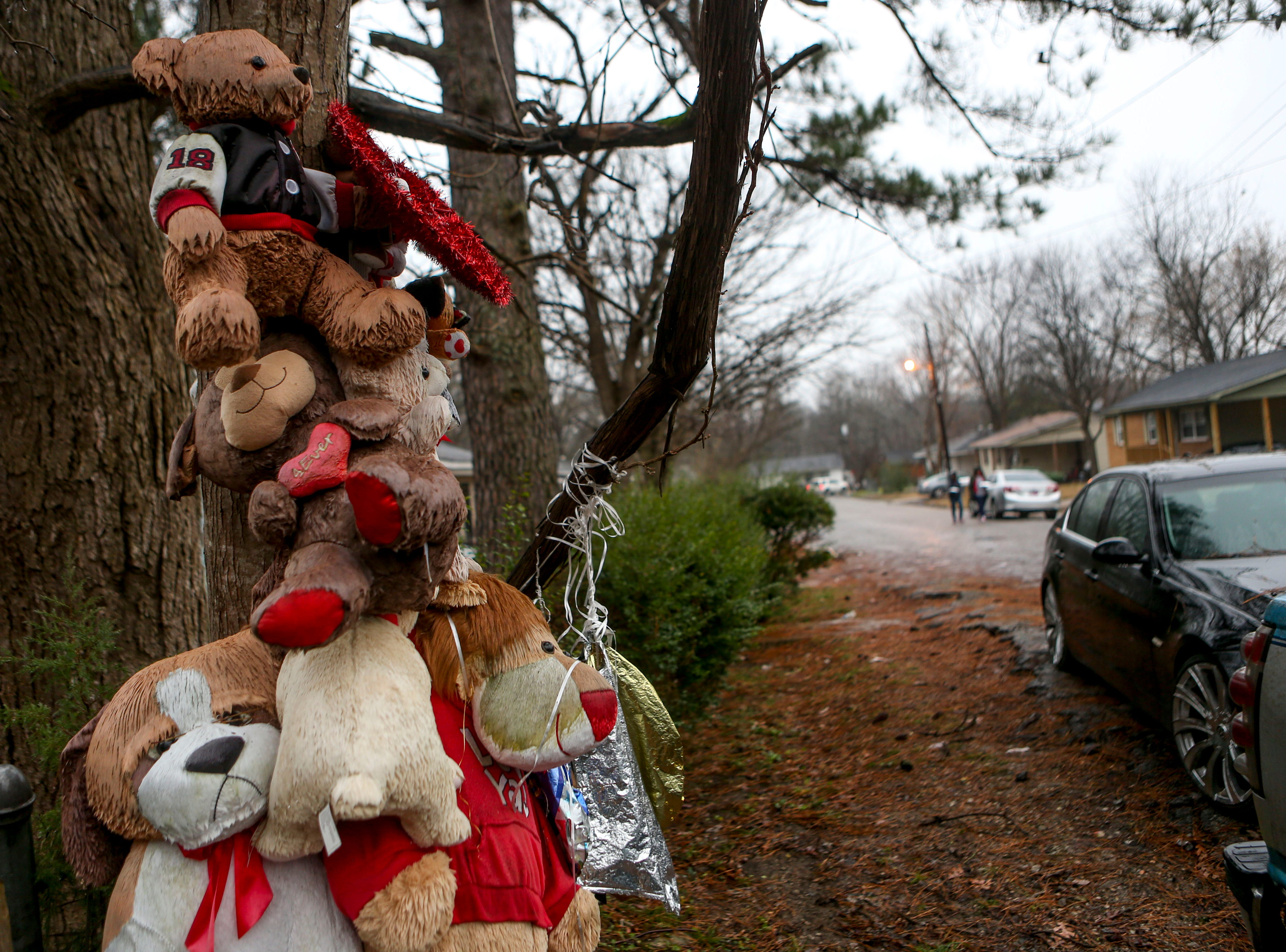 Numerous stuffed animals and ornaments decorate a tree at the location Kentavious Wilson was shot and killed at the previous January at 600 block of Coach Street in Brownsville, Tenn., on Wednesday, Jan. 2, 2019.