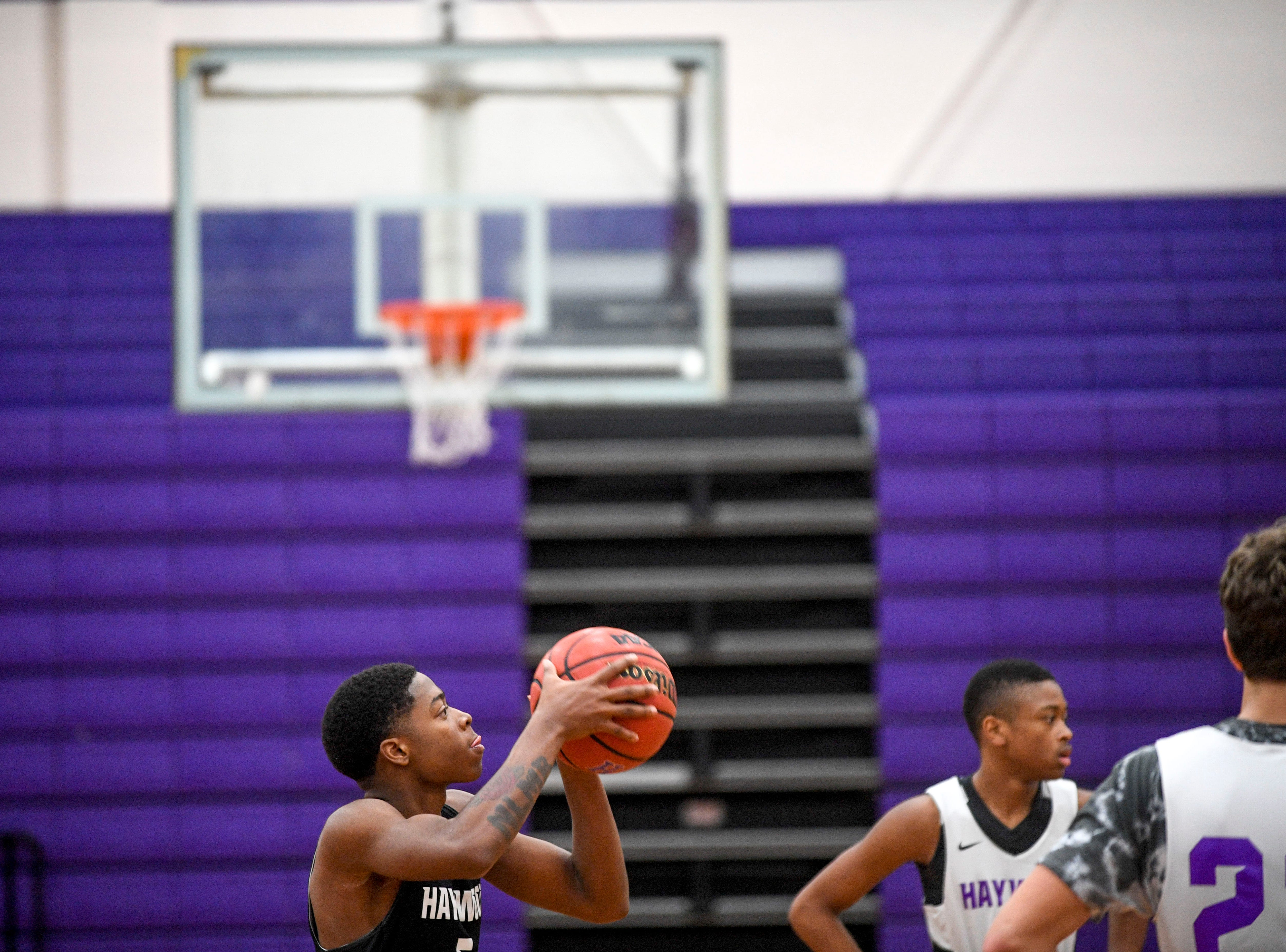 Kyron Stocking looks to take a shot from the free throw line in a 5v5 drill during basketball practice at Haywood High School in Brownsville, Tenn., on Wednesday, Jan. 2, 2019.