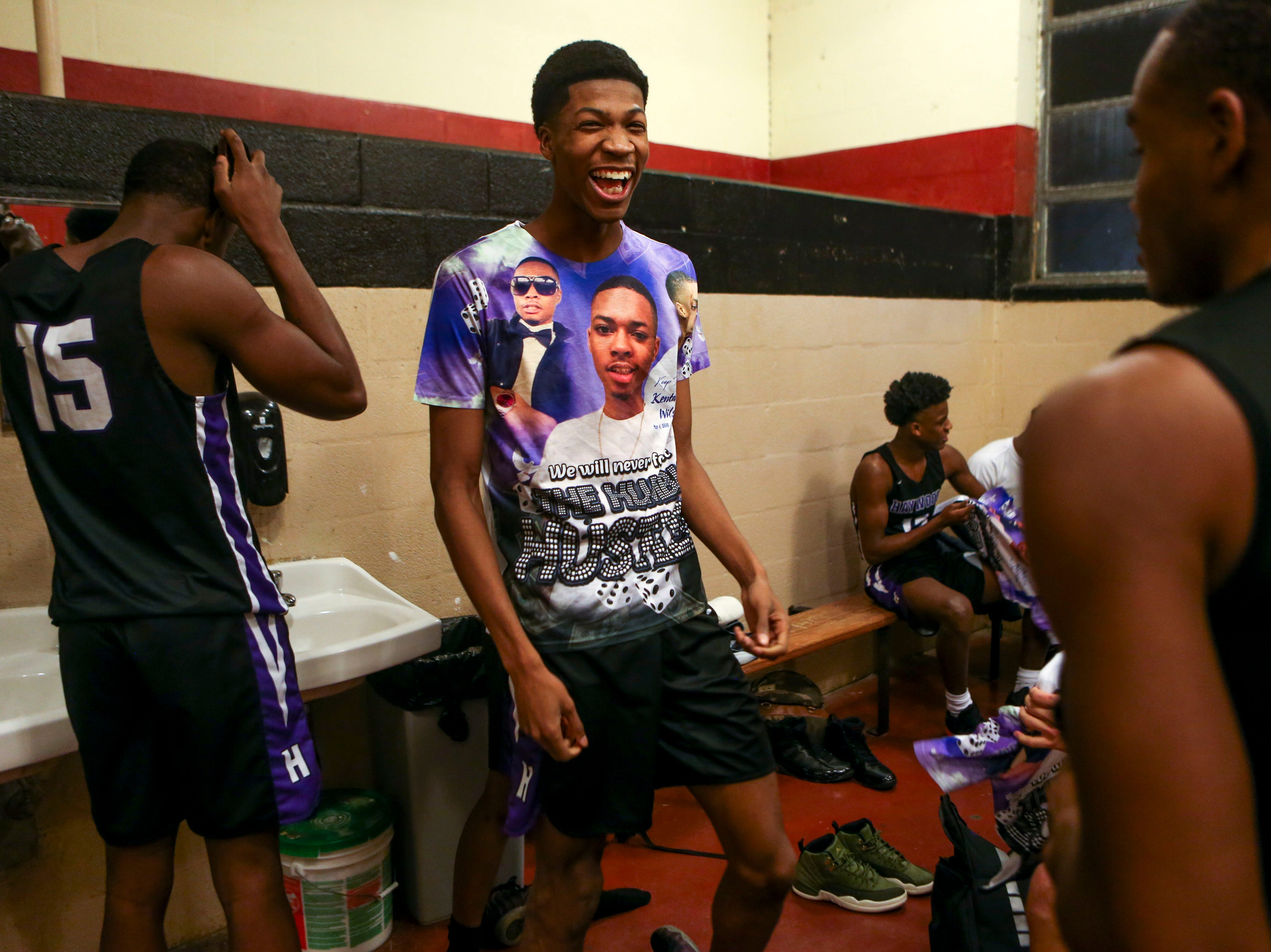 Haywood players laugh with one another in the locker room before a TSSAA basketball game between South Side and Haywood on the anniversary of Kentavious Wilson, a former Haywood player's, death at South Side High School in Jackson, Tenn., on Saturday, Jan. 5, 2019.