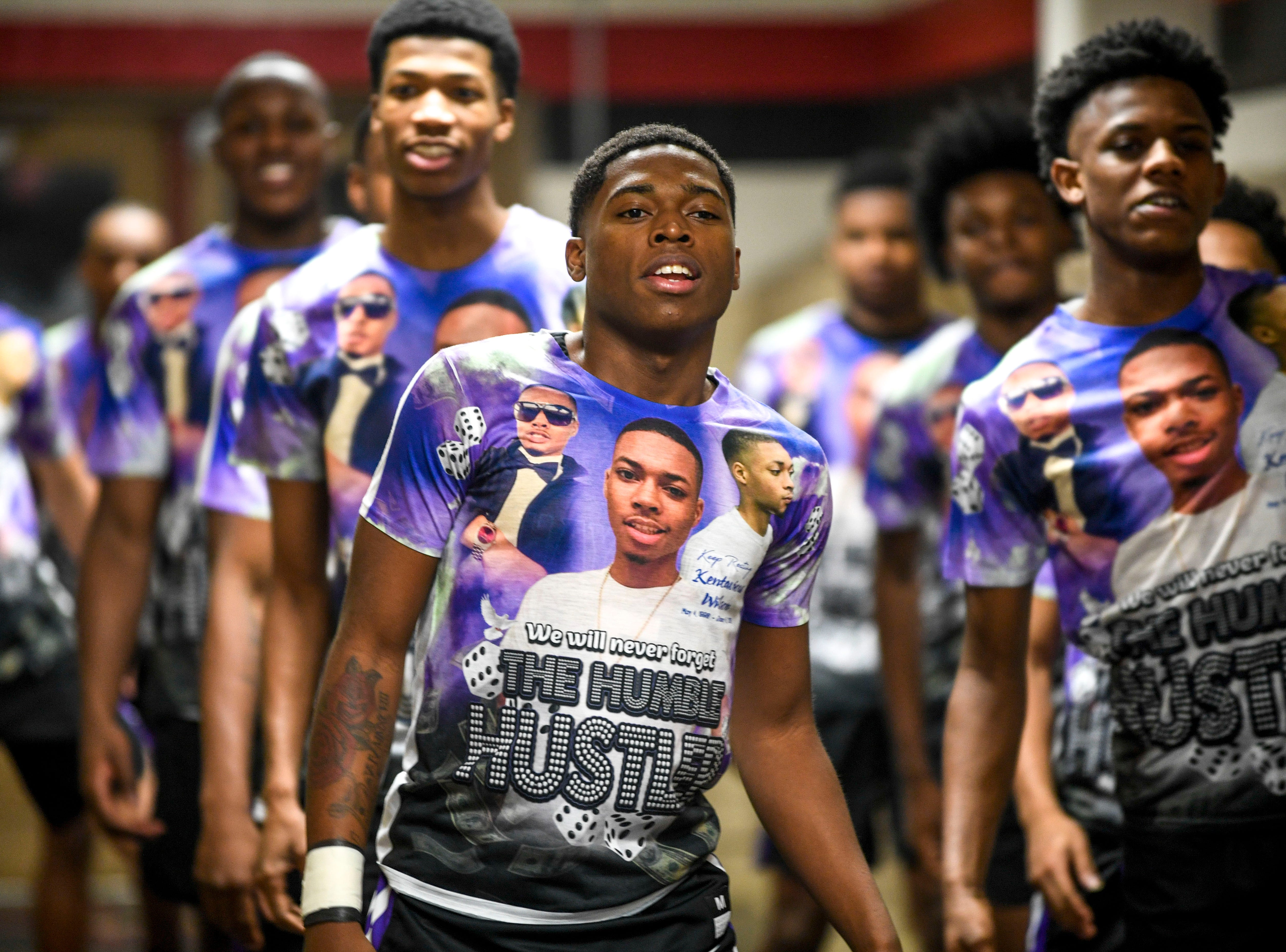 Kyron Stocking leads his team in warm ups during a TSSAA basketball game between South Side and Haywood on the anniversary of Kentavious Wilson, a former Haywood player's, death at South Side High School in Jackson, Tenn., on Saturday, Jan. 5, 2019.