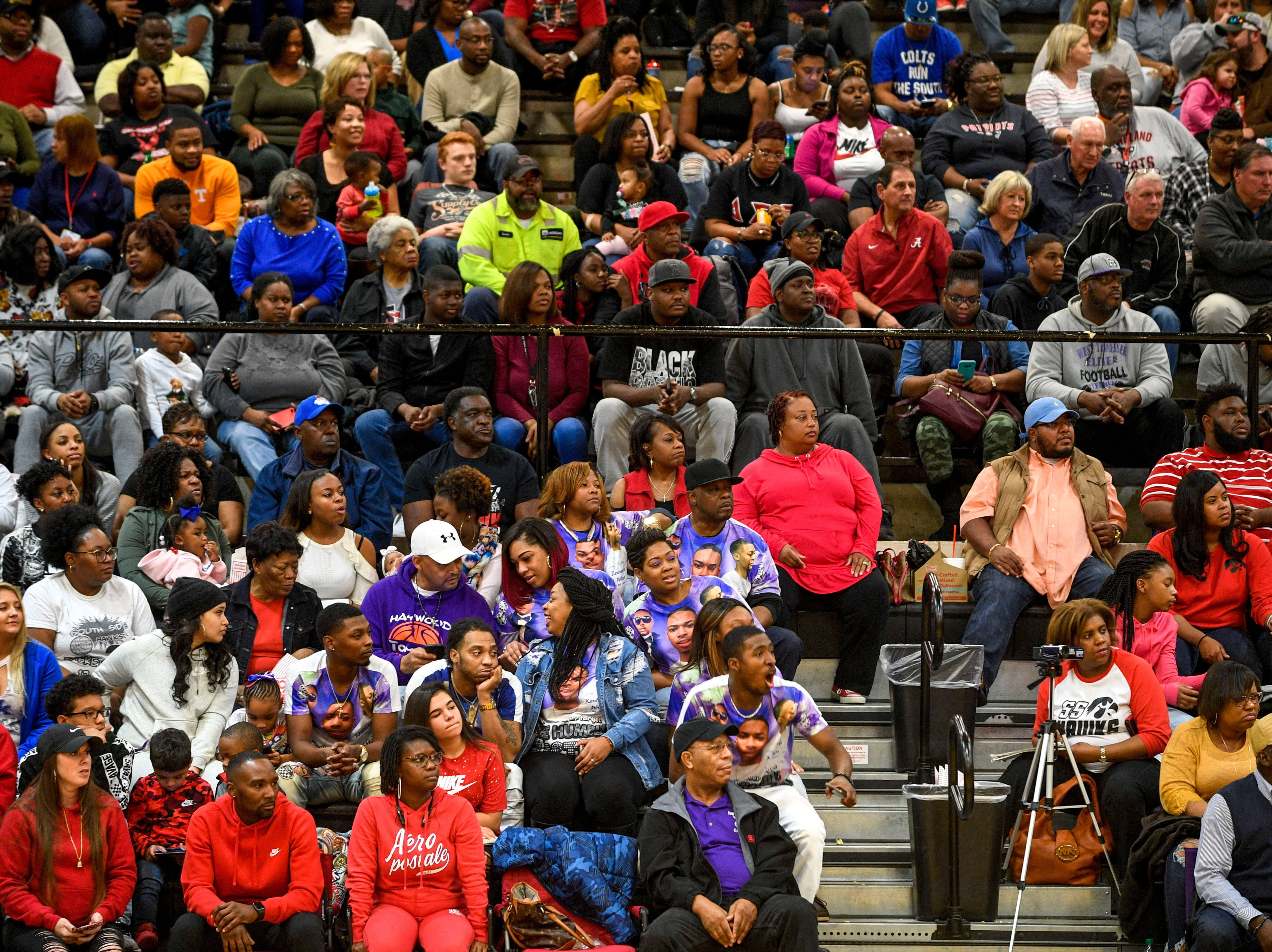 Kemmeka Currie sits with family and friends wearing t-shirts honoring Currie's son Kentavious Wilson during a TSSAA basketball game between South Side and Haywood on the anniversary of Kentavious Wilson, a former Haywood player's, death at South Side High School in Jackson, Tenn., on Saturday, Jan. 5, 2019.