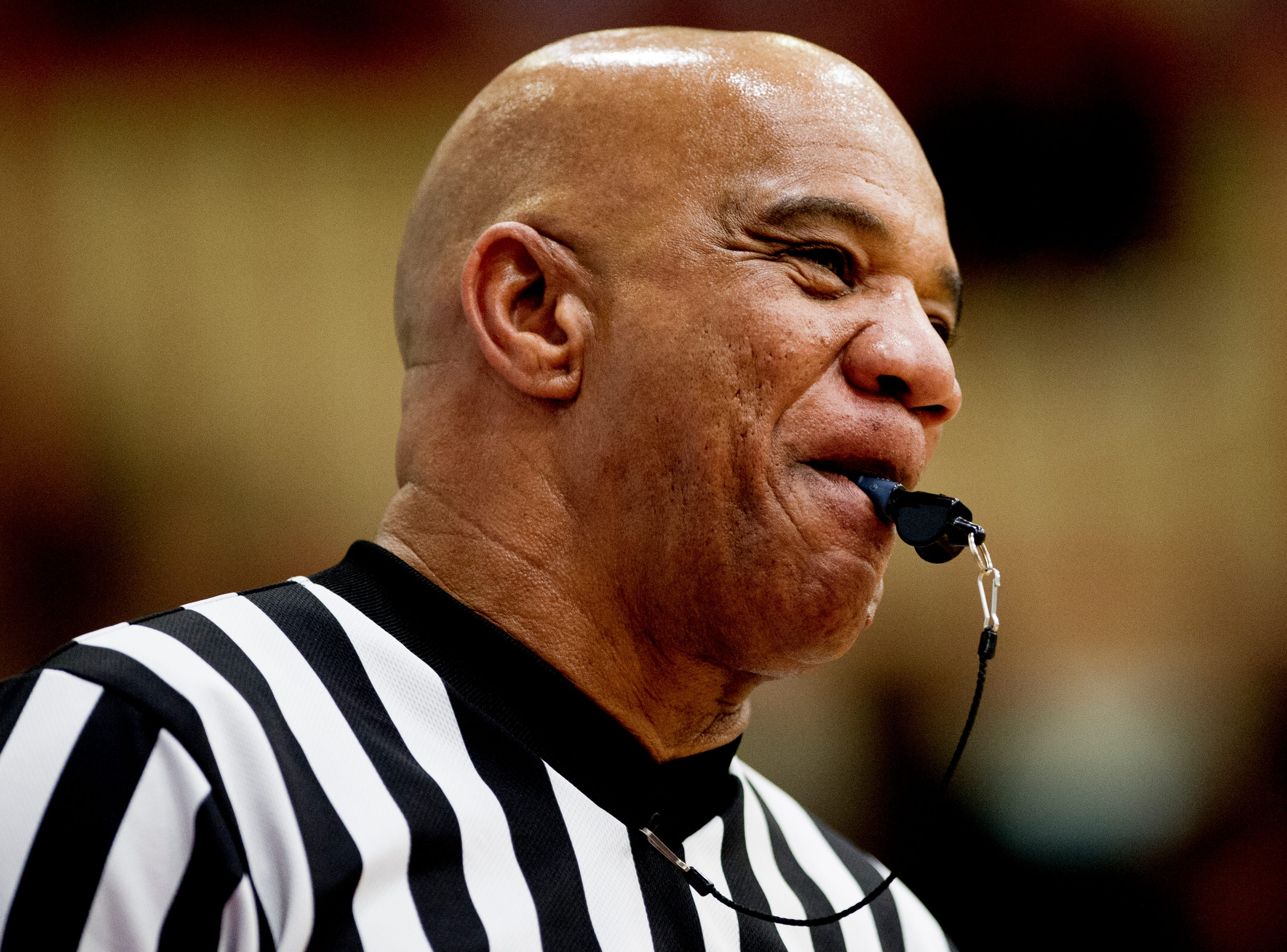 A referee laughs during game action between Austin-East and Fulton at Austin-East High School in Knoxville, Tennessee on Saturday, January 5, 2019.