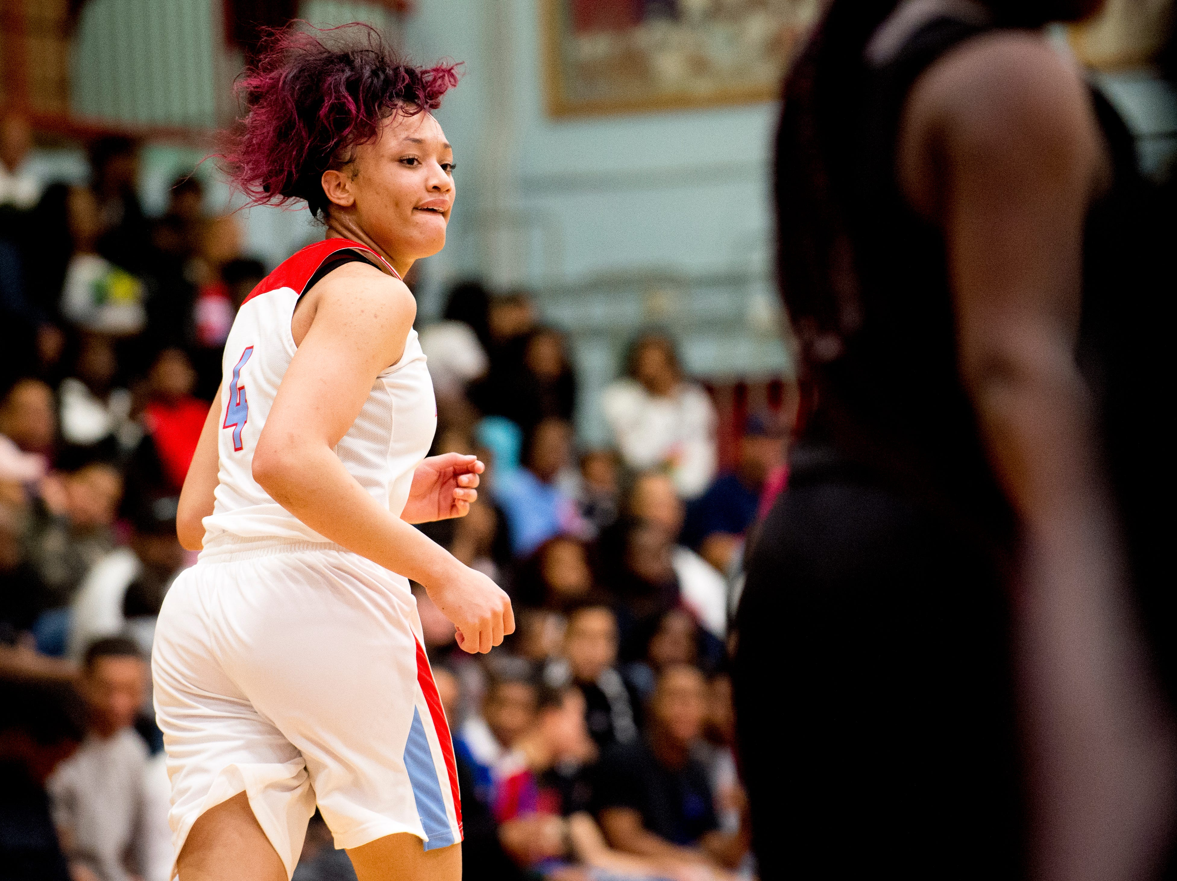 Austin-East's Larriana Bullard (4) reacts after scoring a point during a game between Austin-East and Fulton at Austin-East High School in Knoxville, Tennessee on Saturday, January 5, 2019.