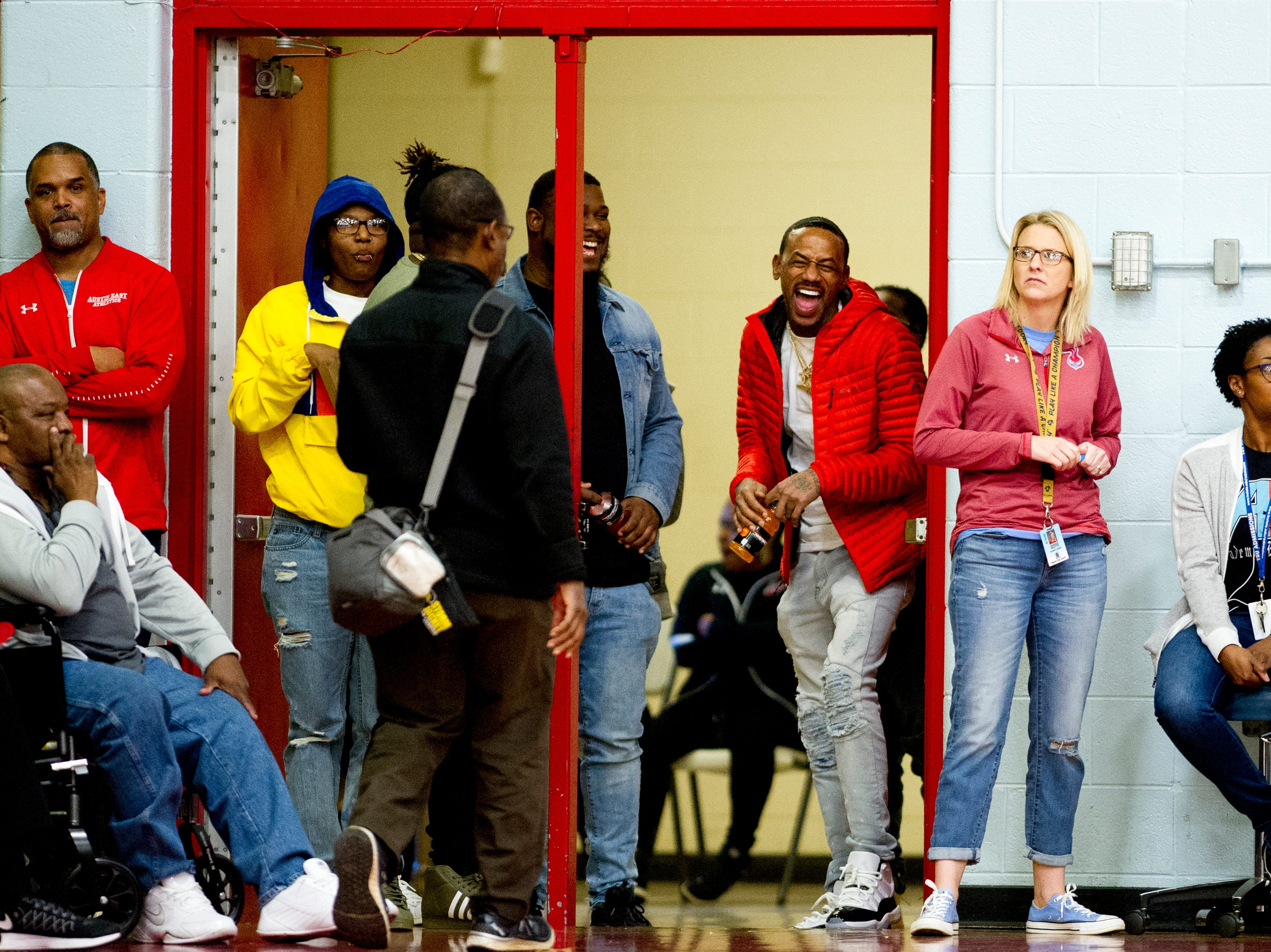 Fans laugh in the doorway during a game between Austin-East and Fulton at Austin-East High School in Knoxville, Tennessee on Saturday, January 5, 2019.