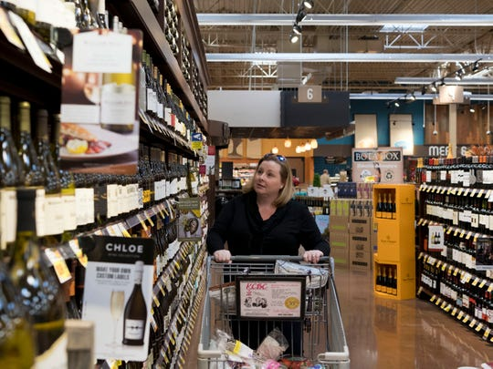 """I'm a white wine person,"" said Erin Pendleton, who browsed the wine section at the Kroger Marketplace in Farragut on Sunday. ""It's about time,"" she remarked on the ability to buy wine on a Sunday. ""We're finally getting into the 21st century."""