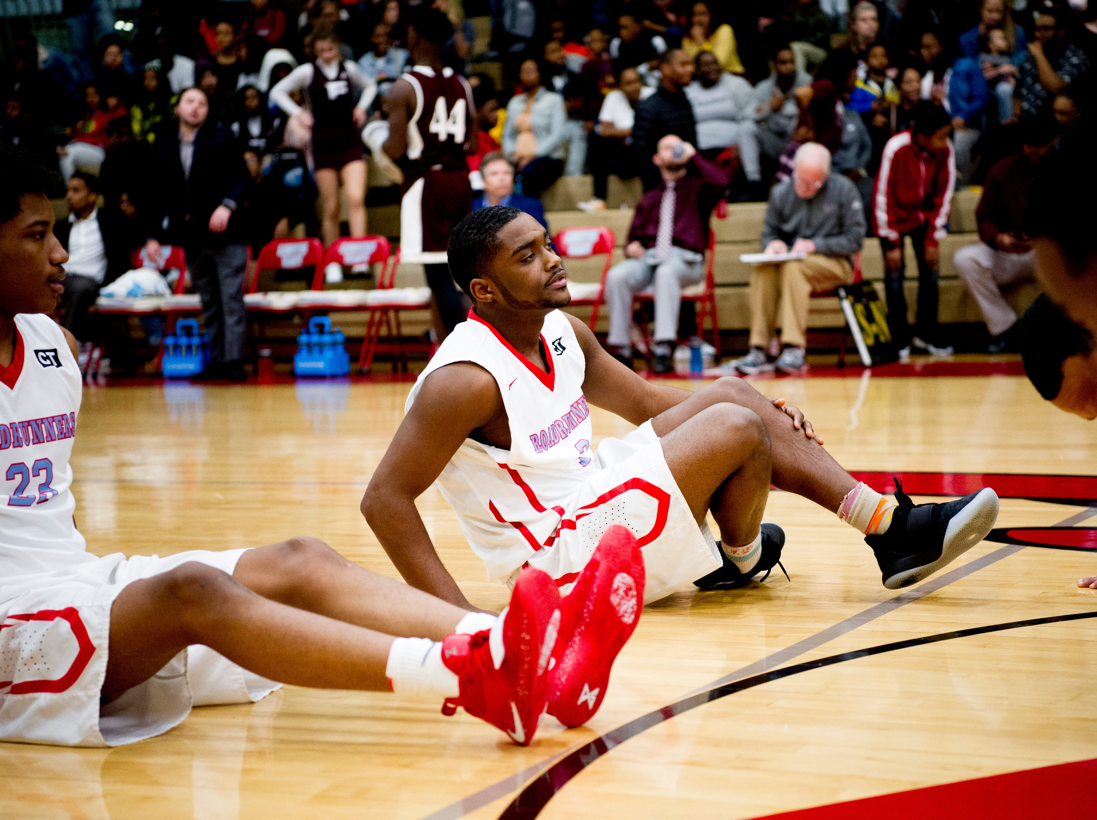 Austin-East's Shiyaun Jackson (2) stretches with team mates during a game between Austin-East and Fulton at Austin-East High School in Knoxville, Tennessee on Saturday, January 5, 2019.