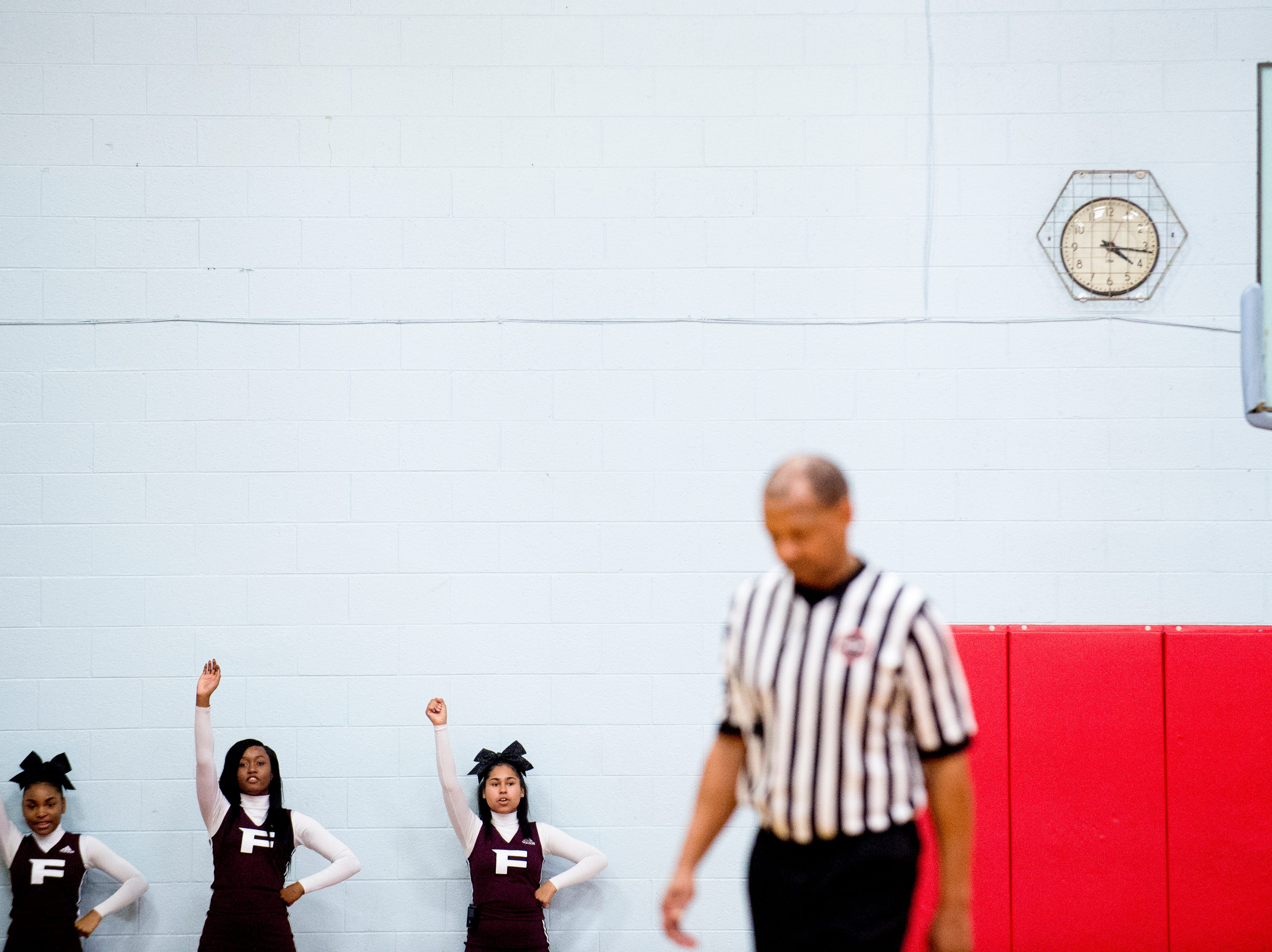 Fulton cheerleaders chant during a game between Austin-East and Fulton at Austin-East High School in Knoxville, Tennessee on Saturday, January 5, 2019.